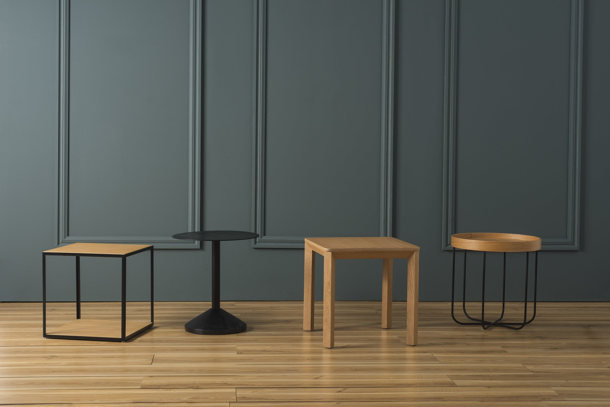 From left to right:  Linear Two Tier Side Table ,  Weight Side Tabl e,  Tilt Side Table ,  Segment Side Table .