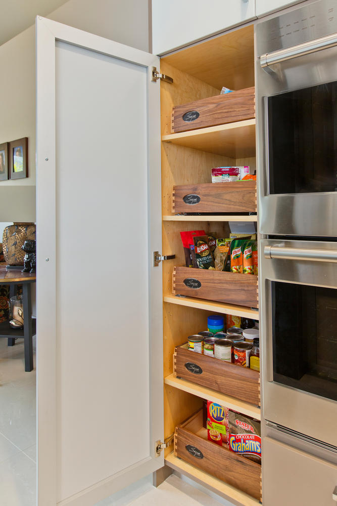 Ovation Cabinetry  offers contemporary beveled furniture quality rollouts and interior drawers
