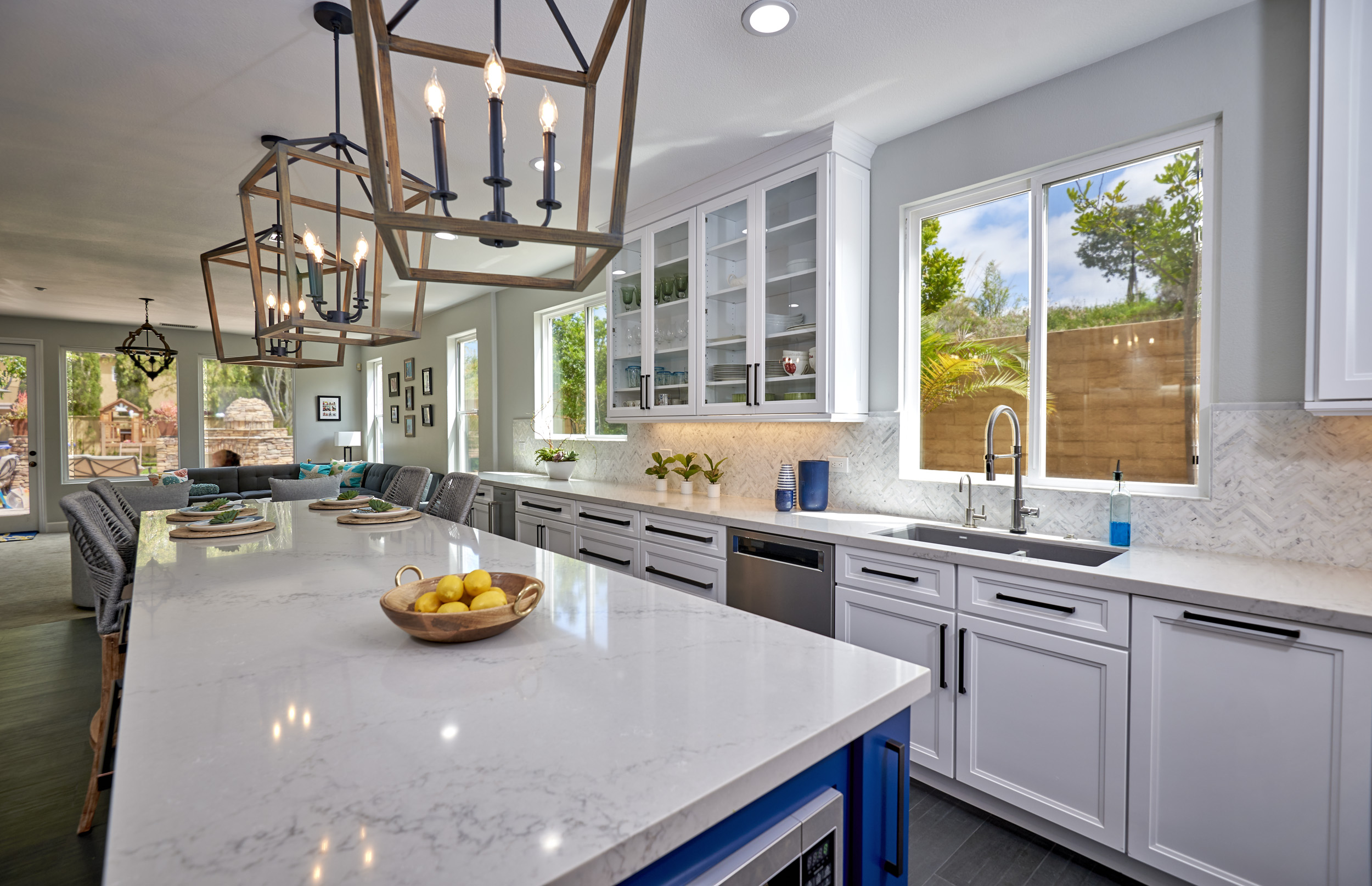 Quartz countertops are the perfect low maintenance finishing element in this kitchen remodel