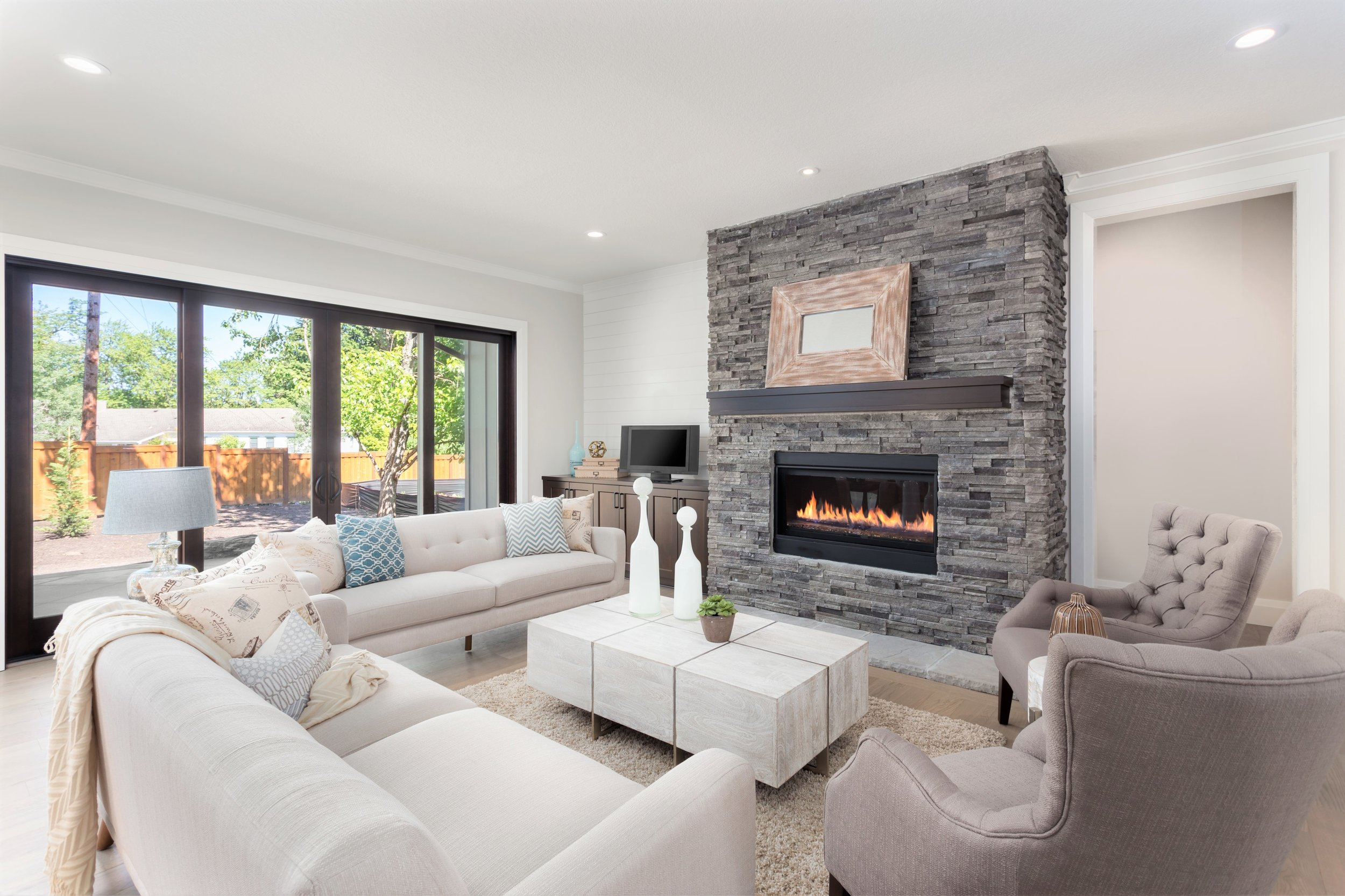 Family Room with stacked stone fireplace .jpeg