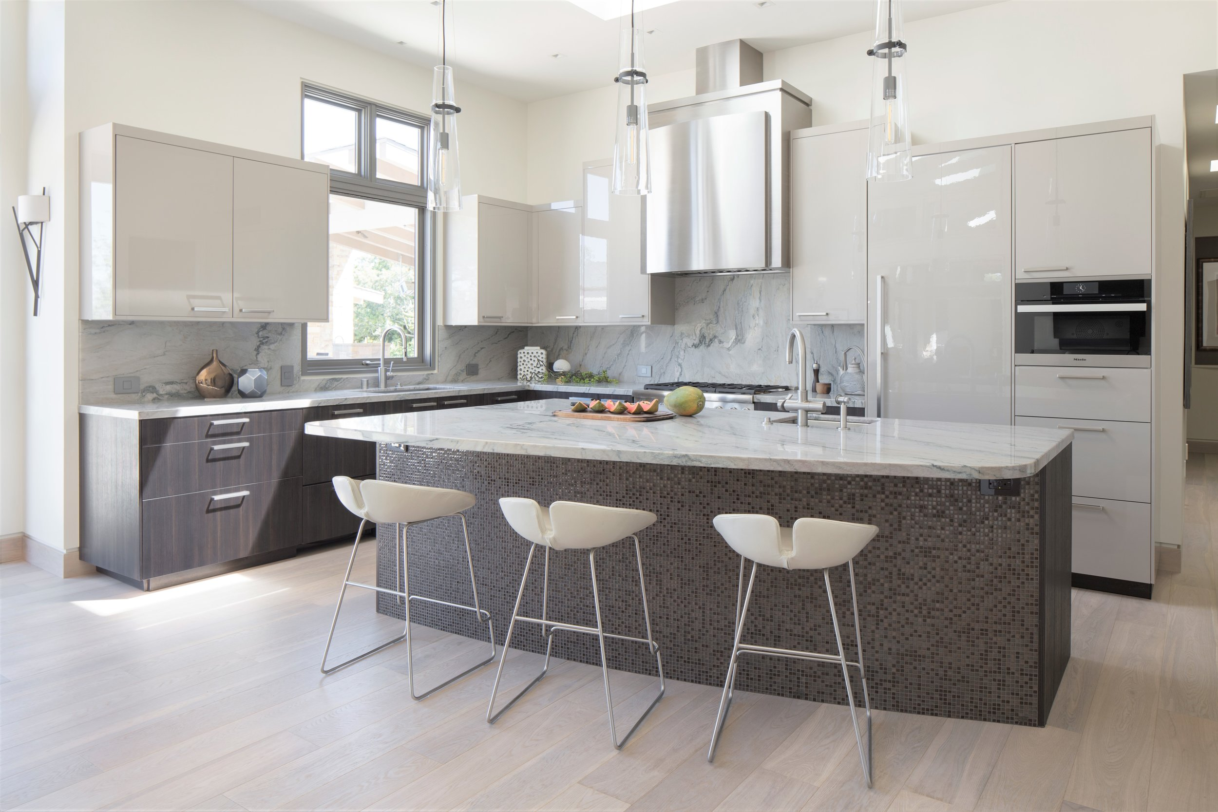 Modern Kitchen in with leather bar stools