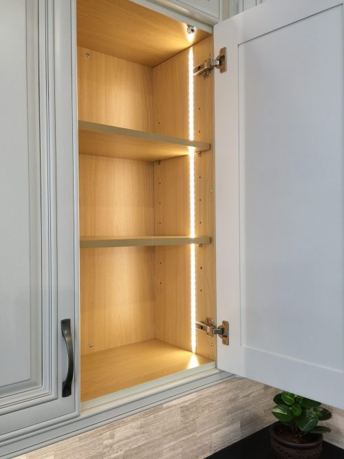 LED Vertical in Cabinet Lighting. Another trend that we are seeing is LED Strips installed vertically inside cabinets. This needs to be thought about prior to placing your order for your cabinets..