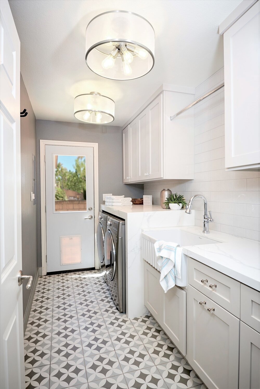A Del Mar Laundry Room that has storage for pet food and more!
