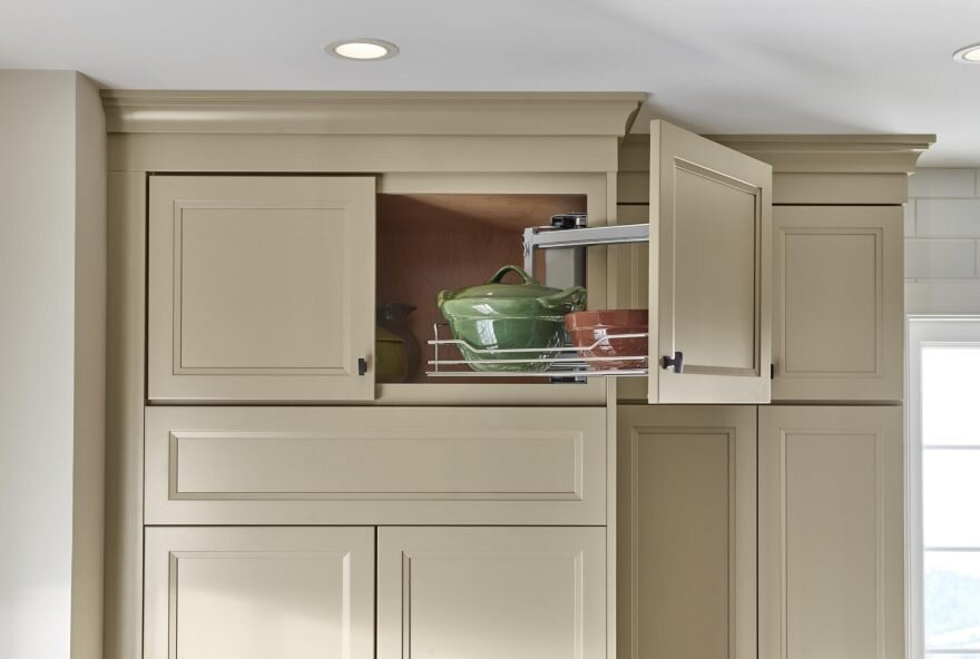 Above Appliance Swing Out Organizer   One of the more in-depth products on our list, is an organizer that works perfectly over the oven or fridge. It can be side mounted to either the left or right side of the cabinet wall.