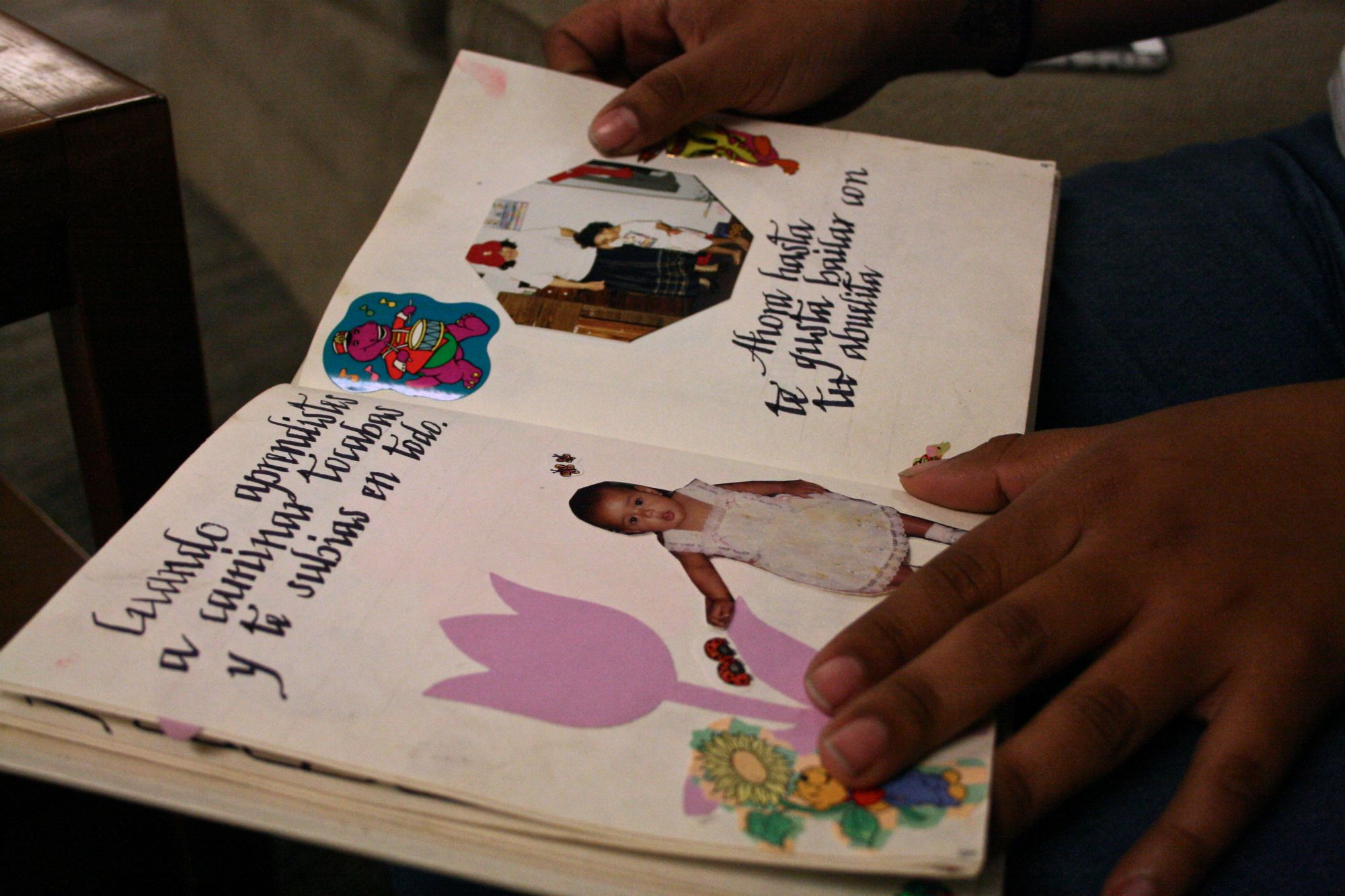 "Reeb Menjivar shows a book her mother handmade for her at Arizona State University in Tempe, Ariz. on April 15, 2016. """"My mom has always been the one who really taught me a little bit about what I do know about Salvadorean culture,"" she said. ""Because my grandpa's always been like 'you're American!' Because I guess he kind of didn't want us to miss out on anything because of discrimination that happens ... But I was telling him recently, 'I'm brown!' I look like this and I can't hide and I'm not gonna try to be something I'm not. Yes, I was born here and I recognize that, but I still hold strong to being proud of being Salvadorean. I think he was doing it out of love and protection, but it was wrong of him to do. I'm not mad at him, but I've gotten into conversations with him. We can't disregard our own culture. It shapes who were are."""