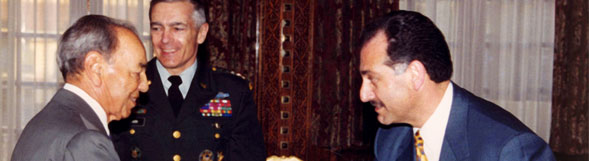 Then-Supreme Allied Commander General Wesley Clark and Ambassador Gabriel discuss closer NATO ties with late King Hassan II of Morocco