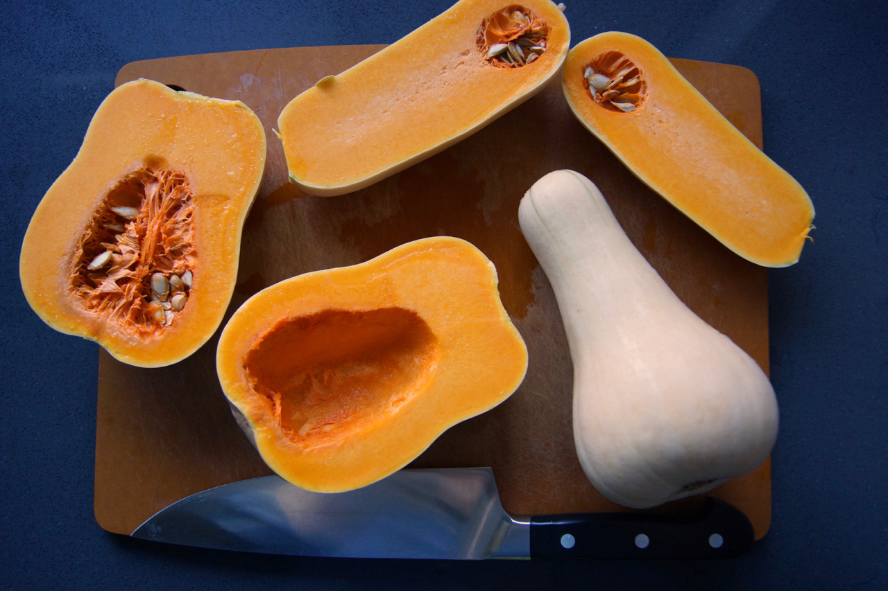 Cut the squash, and scoop out the seeds.