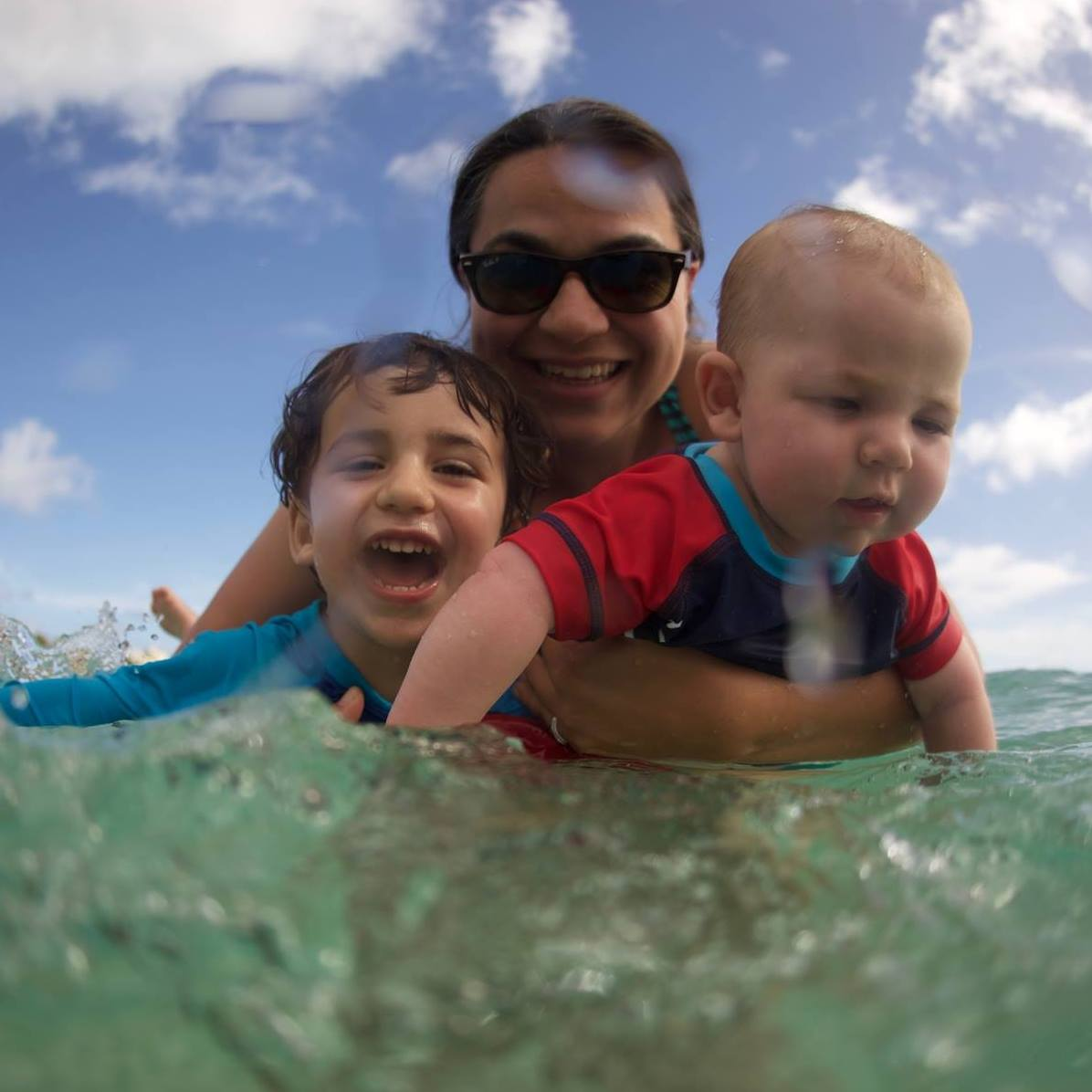 Me and my water babies playing in the ocean at a warmer time of year.