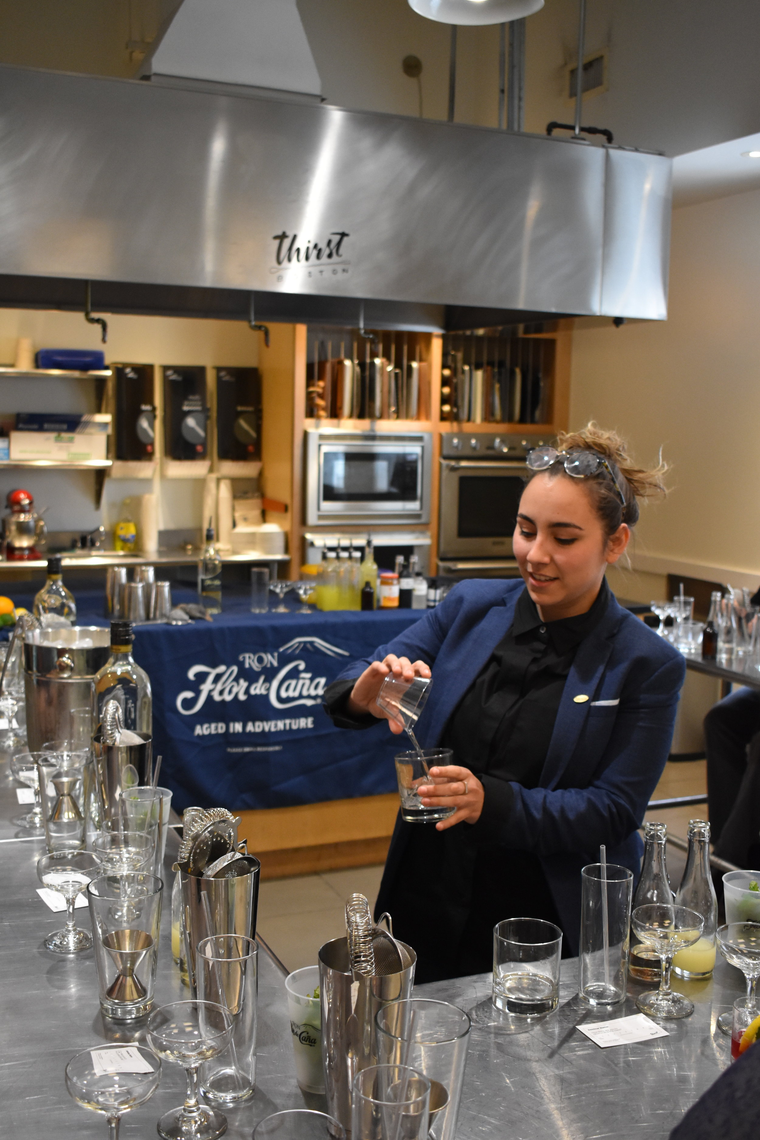 Flor de Caña's Kayla Quigley exchanges a plastic cup for a glass of rum.