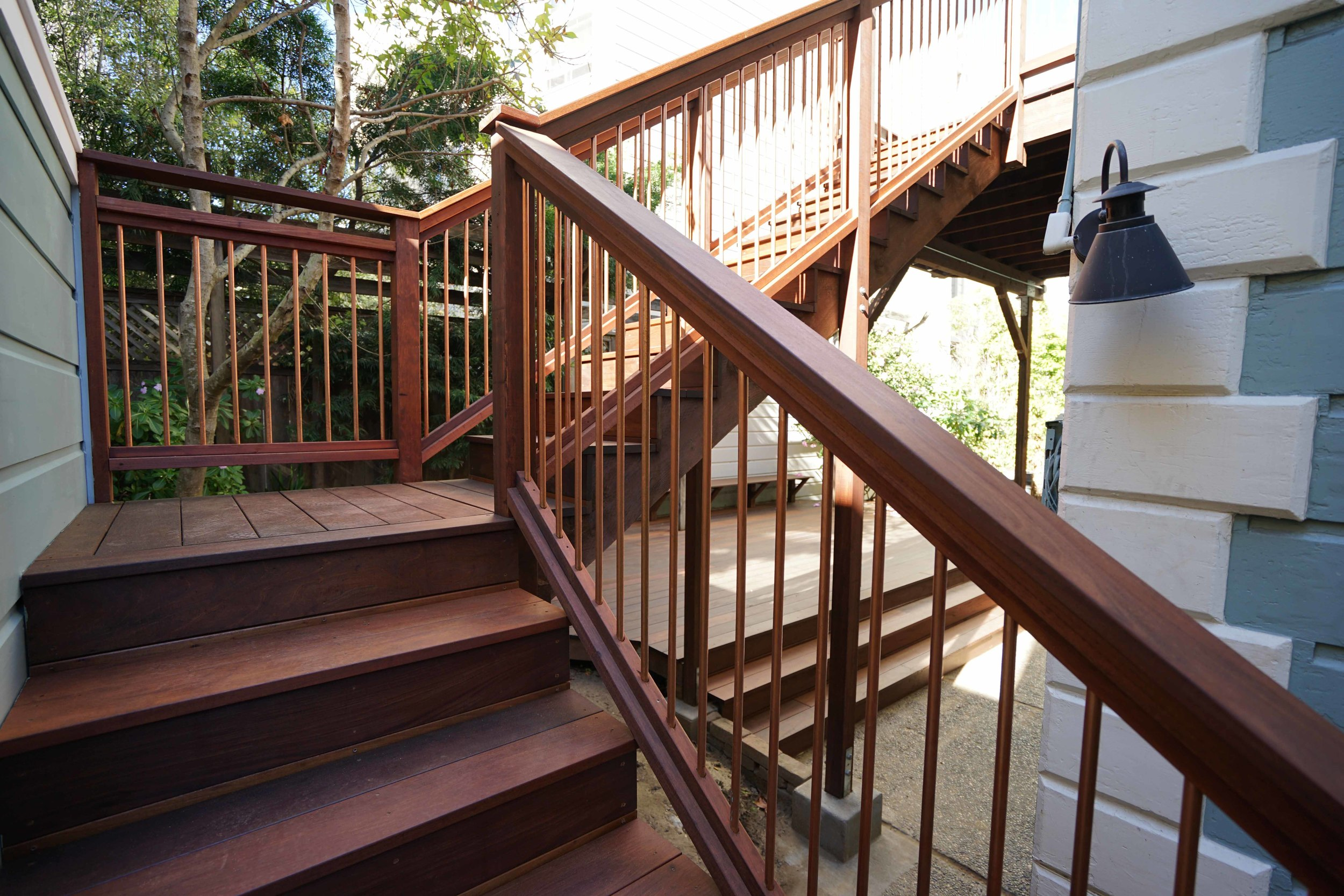 Scott Street Deck with copper balusters completed with variance