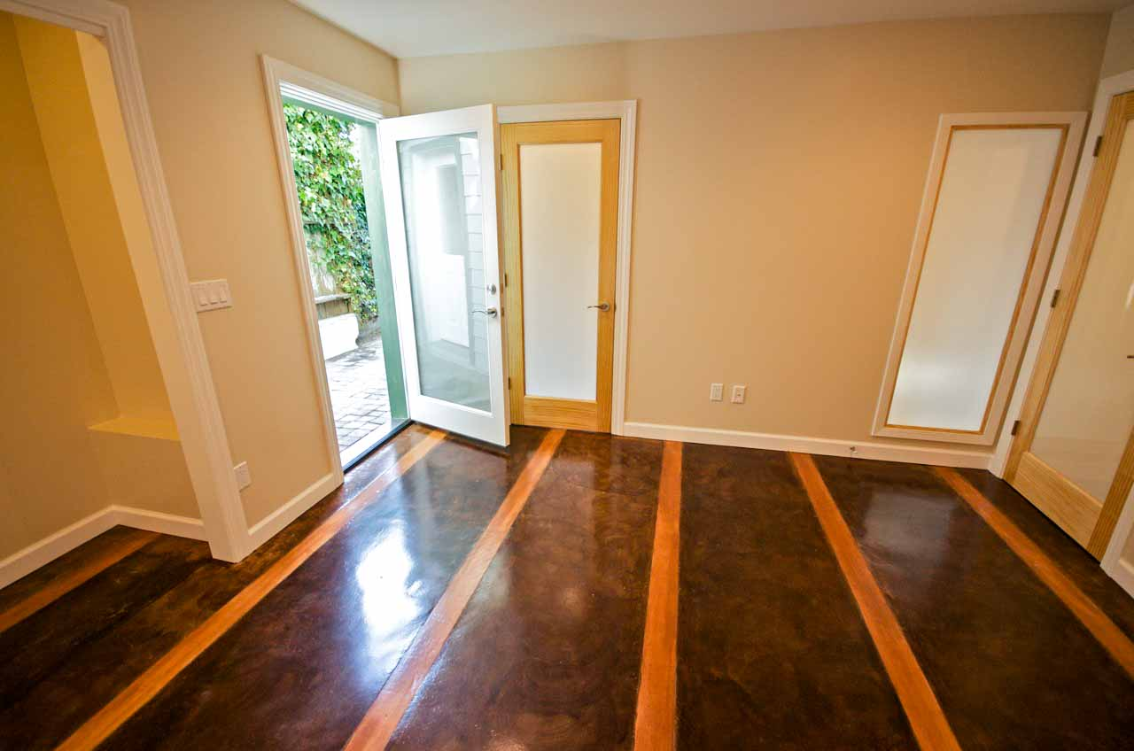 Stained concrete and inlaid wood floor