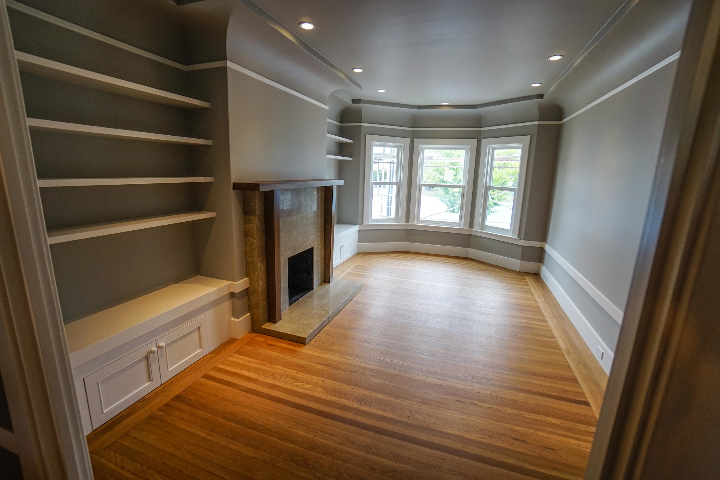 built in shelving and fireplace