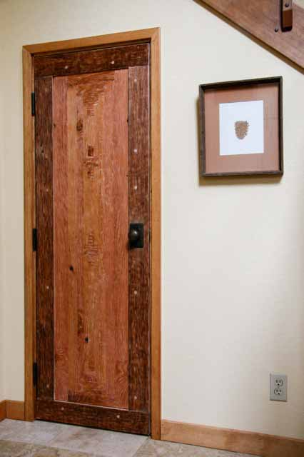 handmade door from salvaged doug fir water tank boards