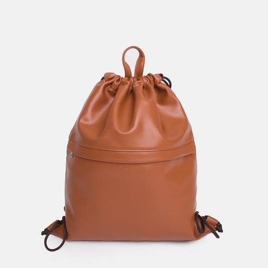 DRAWSTRING - DESIGN 2   Material used: Daily Vegan Leather  Custom Application: Metal Stamping