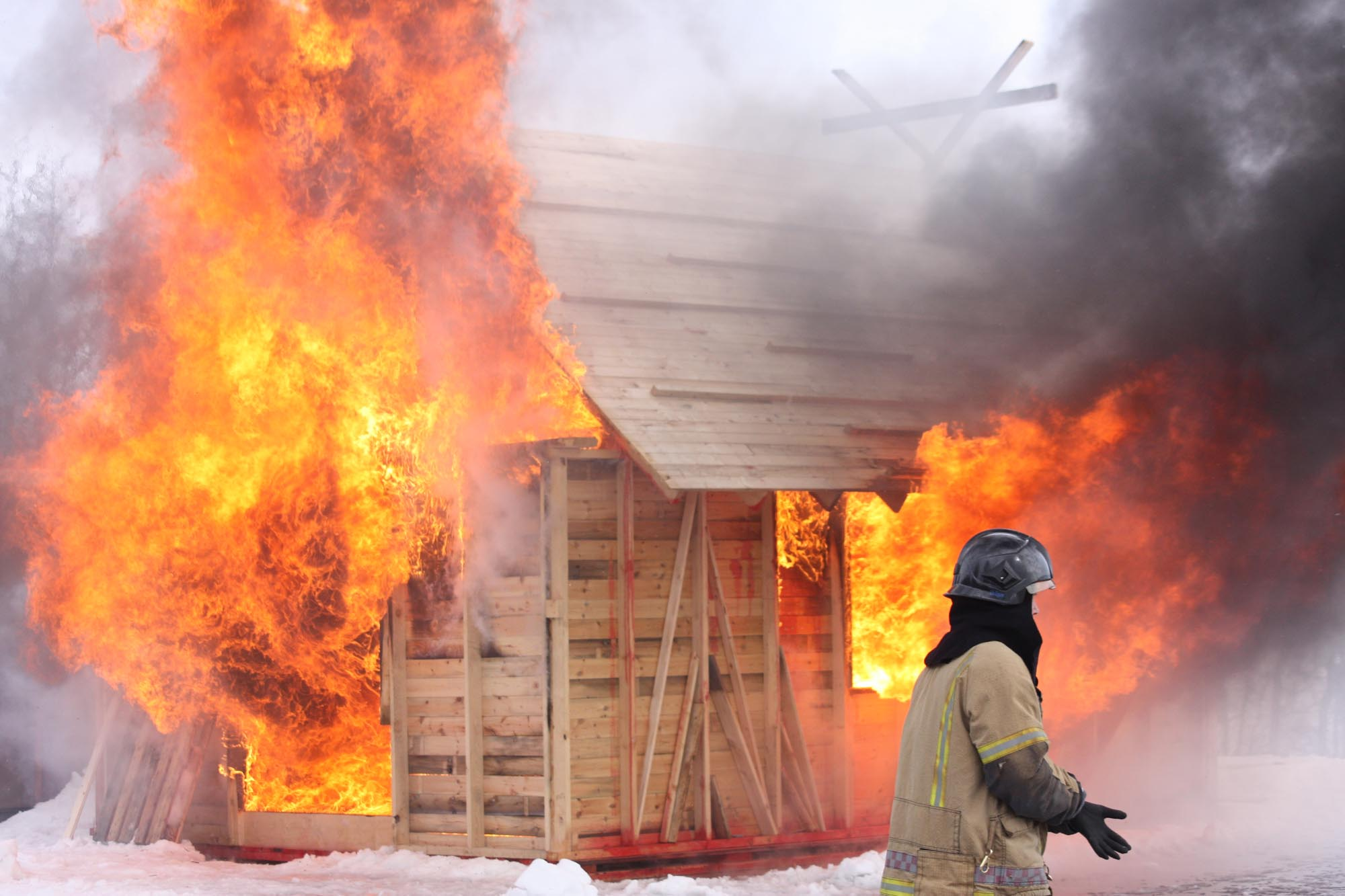 A wooden hut in flames
