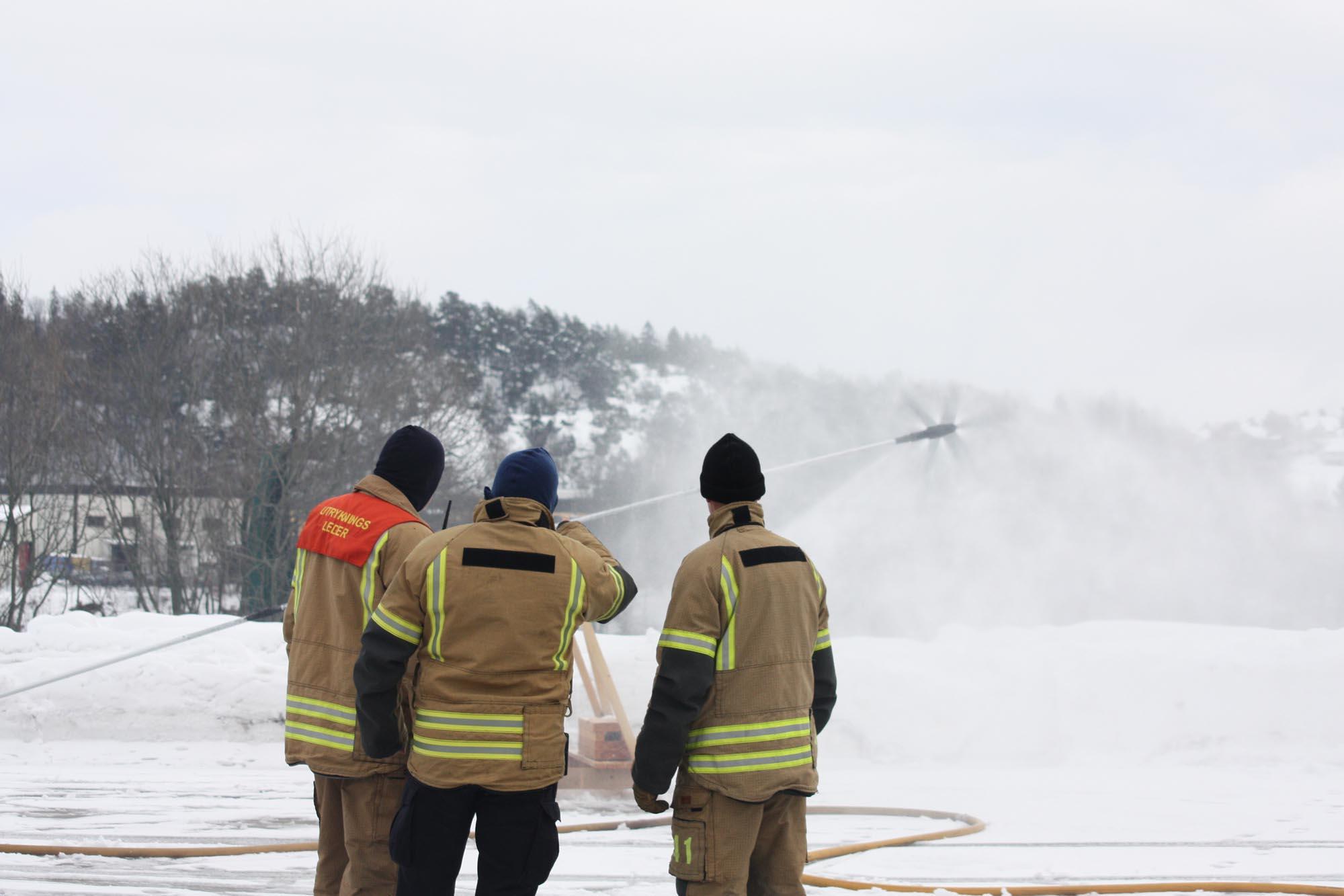 Firefighters operating Firelance