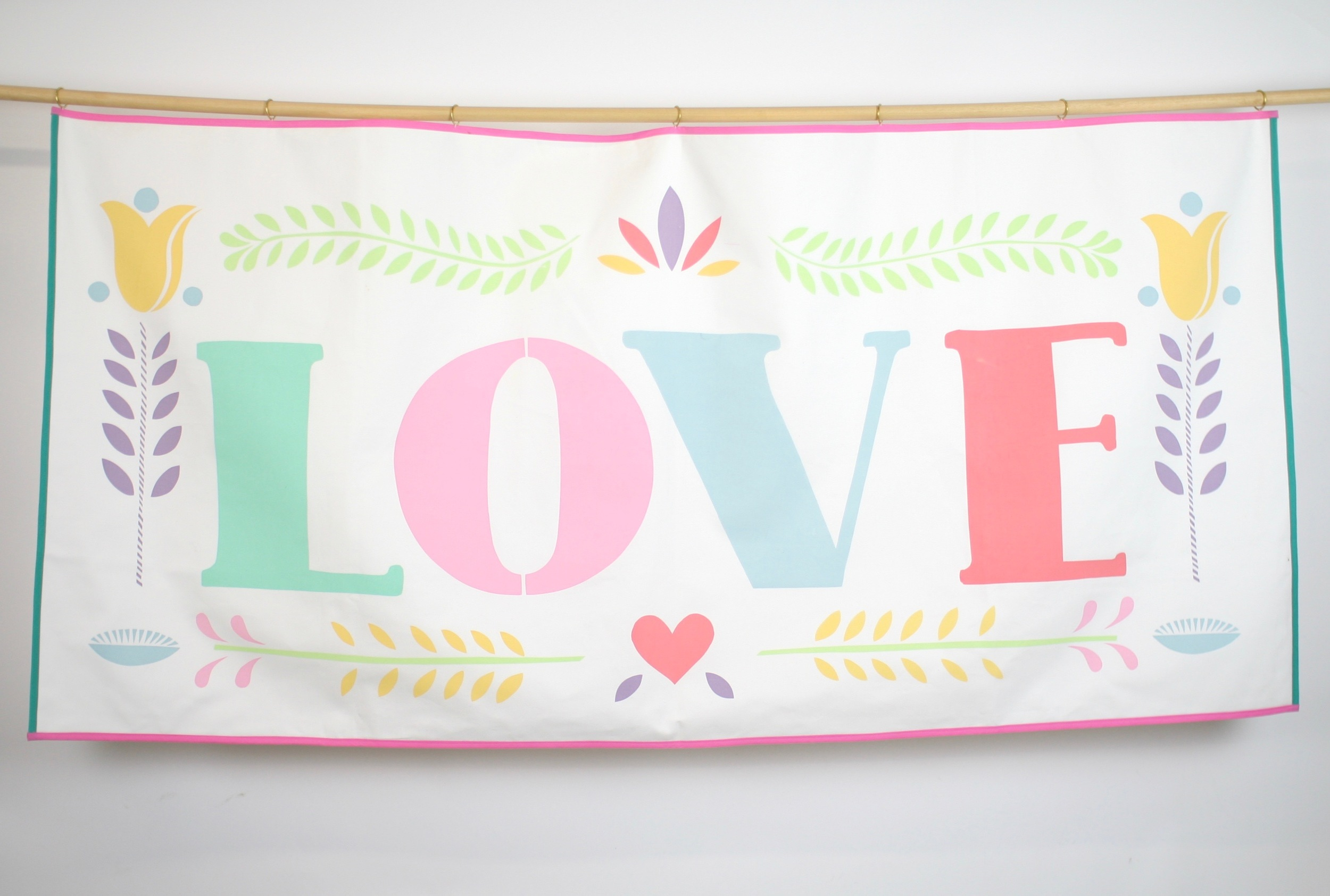 Hand screen printed banner measures 152 cm x 74 cm  The banner is backed with the same soft brushed cotton as the front and has seven brass rings for hanging. Trimmed with green and pink ribbon.  HIRE:£50 BUY:£150 BESPOKE:Prices from £250