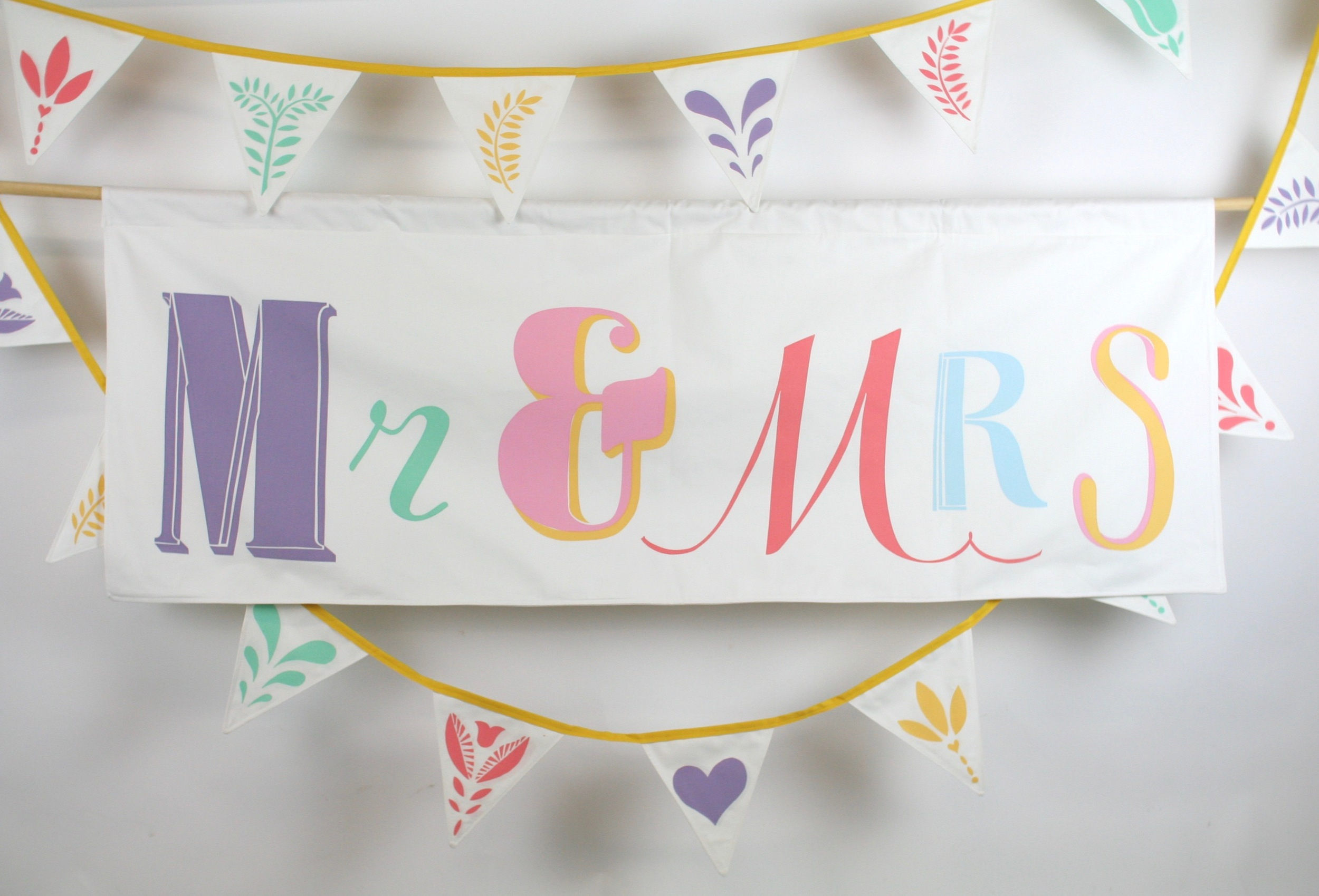 Hand screen printed banner measures 150 cm x 55 cm  The banner is backed with the same soft brushed cotton as the front and has an integral channel for the hanging pole.   HIRE:  £50   BUY:  £150   BESPOKE:  Prices from £250