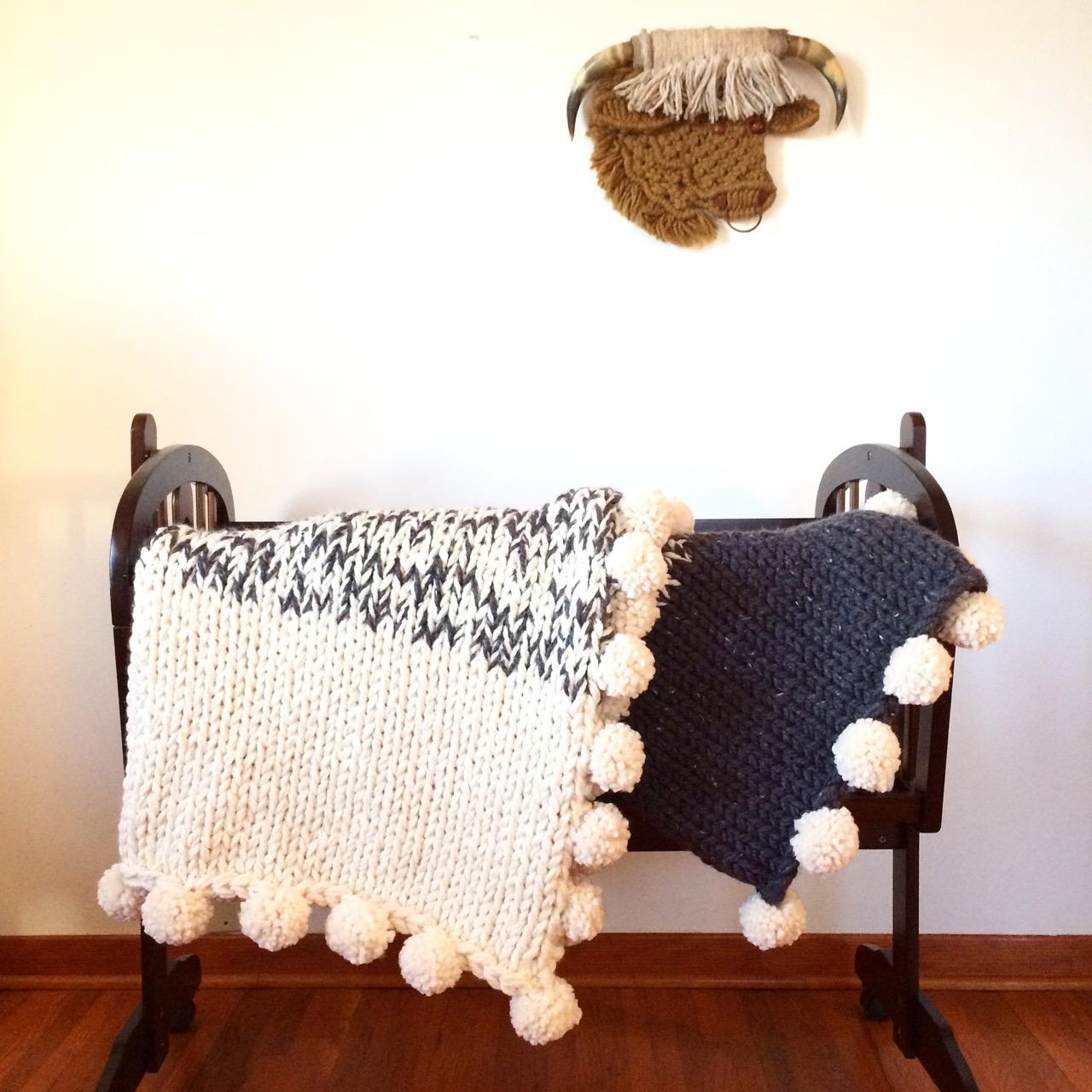 chunky knit sweater blanket with pom poms