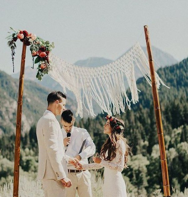 Minimalist macramé wedding backdrop, via thebohemianwedding.com .