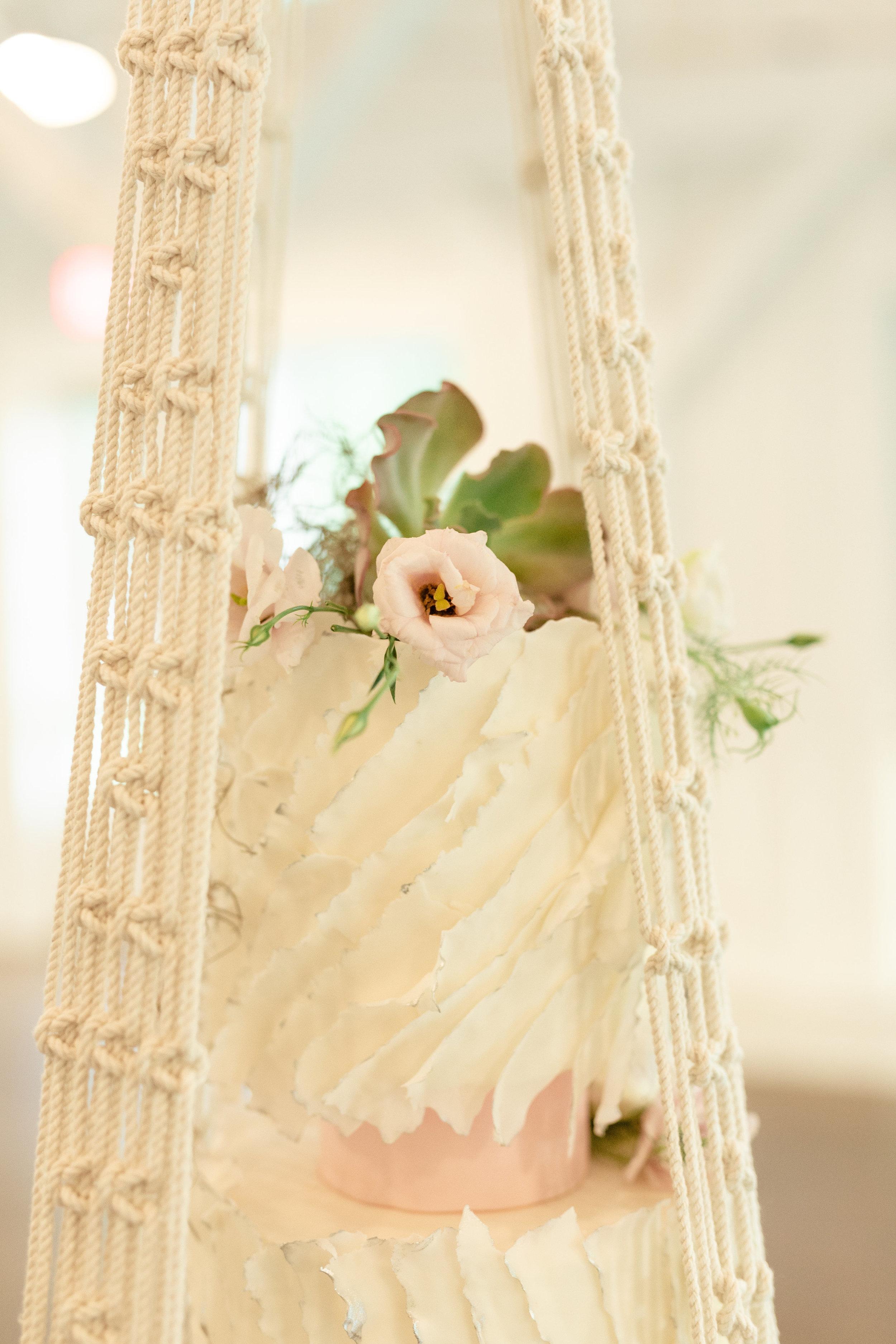 macrame wedding cake beach reception.jpg
