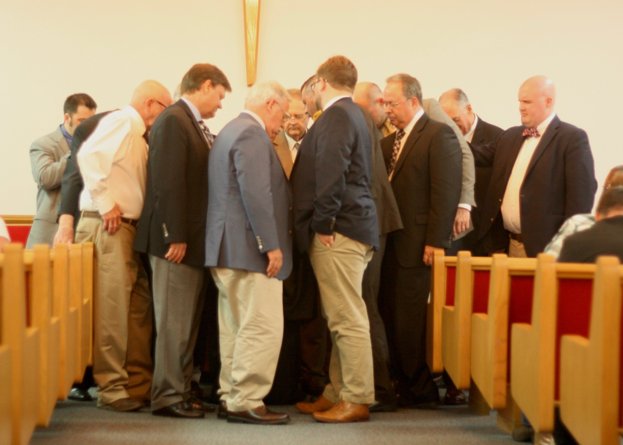 WPC's elders and local area pastors lay their blessings on WPC's newly ordained pastor