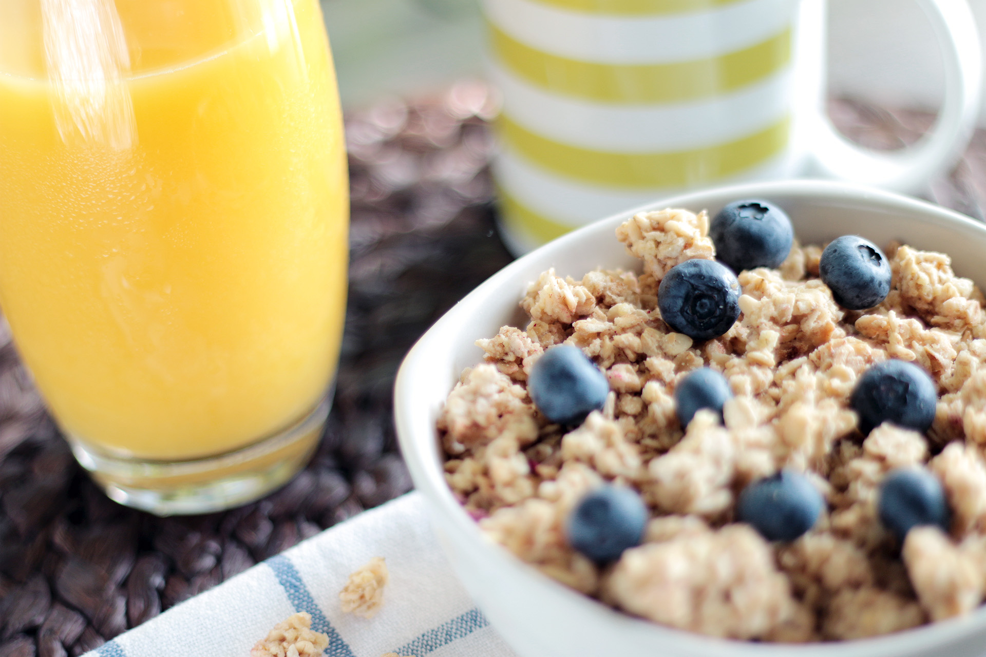 Canva - Bowl of Oatmeal With Berries Beside Glass of Juice.jpg