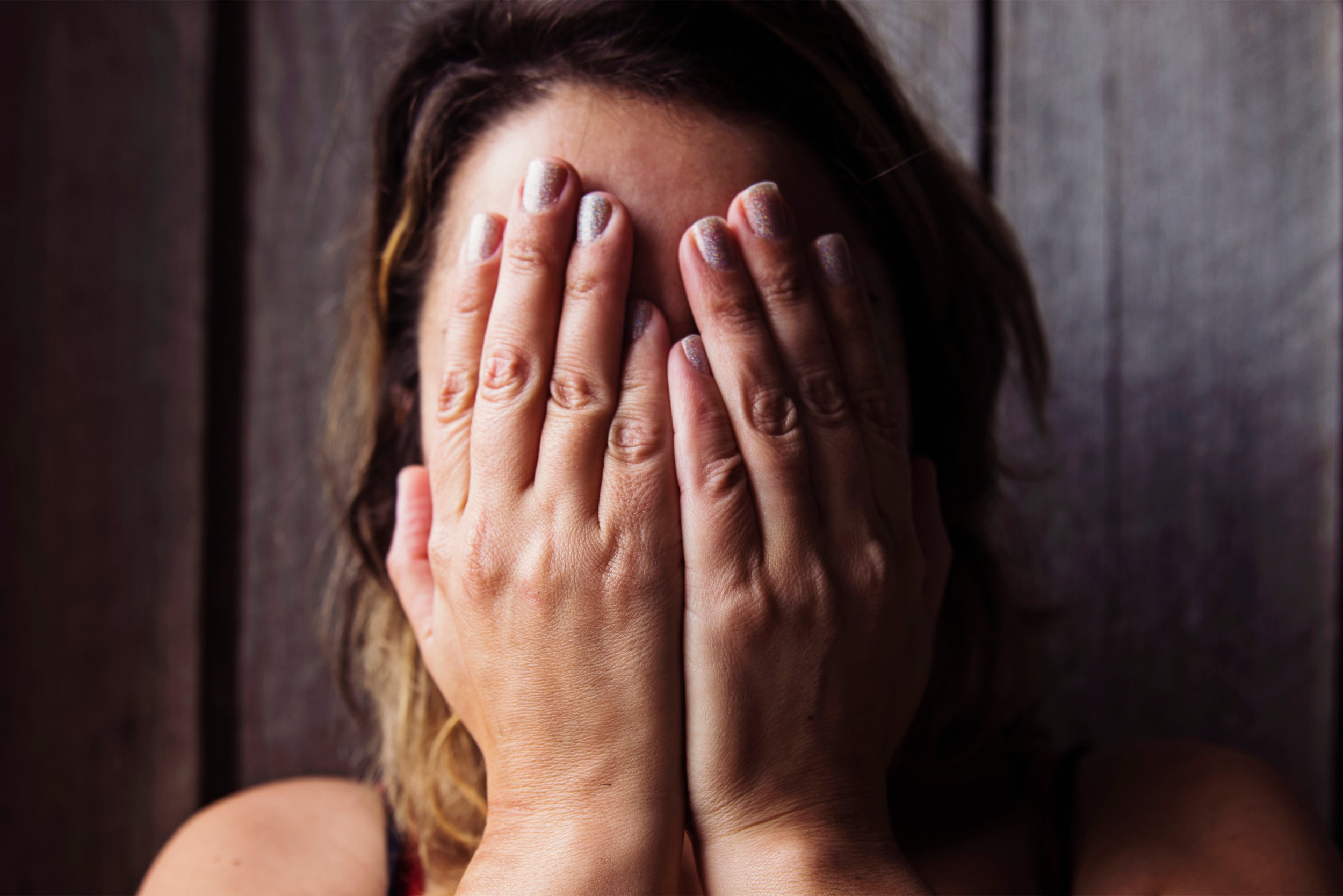 Canva - Woman Covering Her Face With Her Hands.jpg