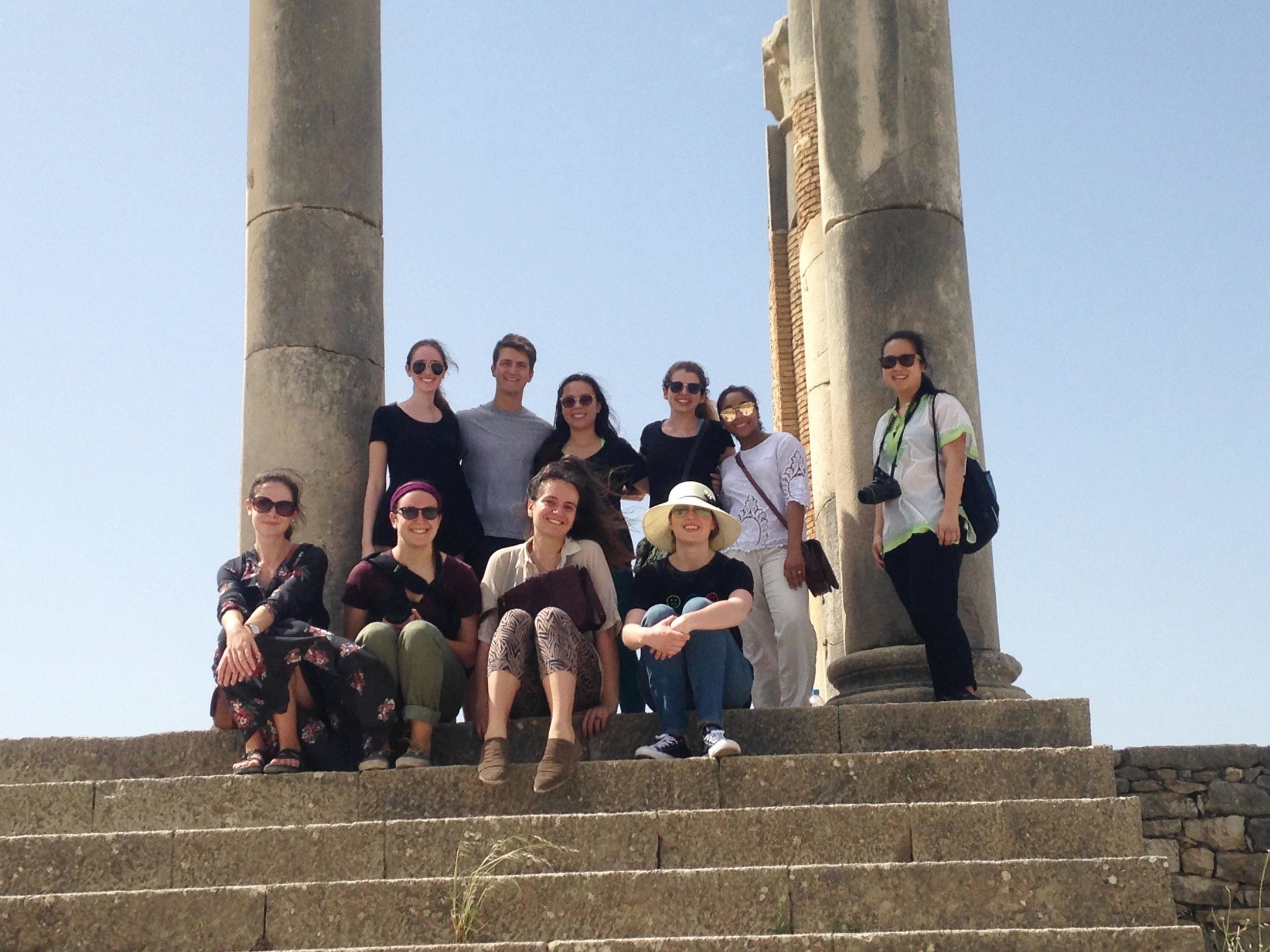 Students sit on the stairs of Volubilis.