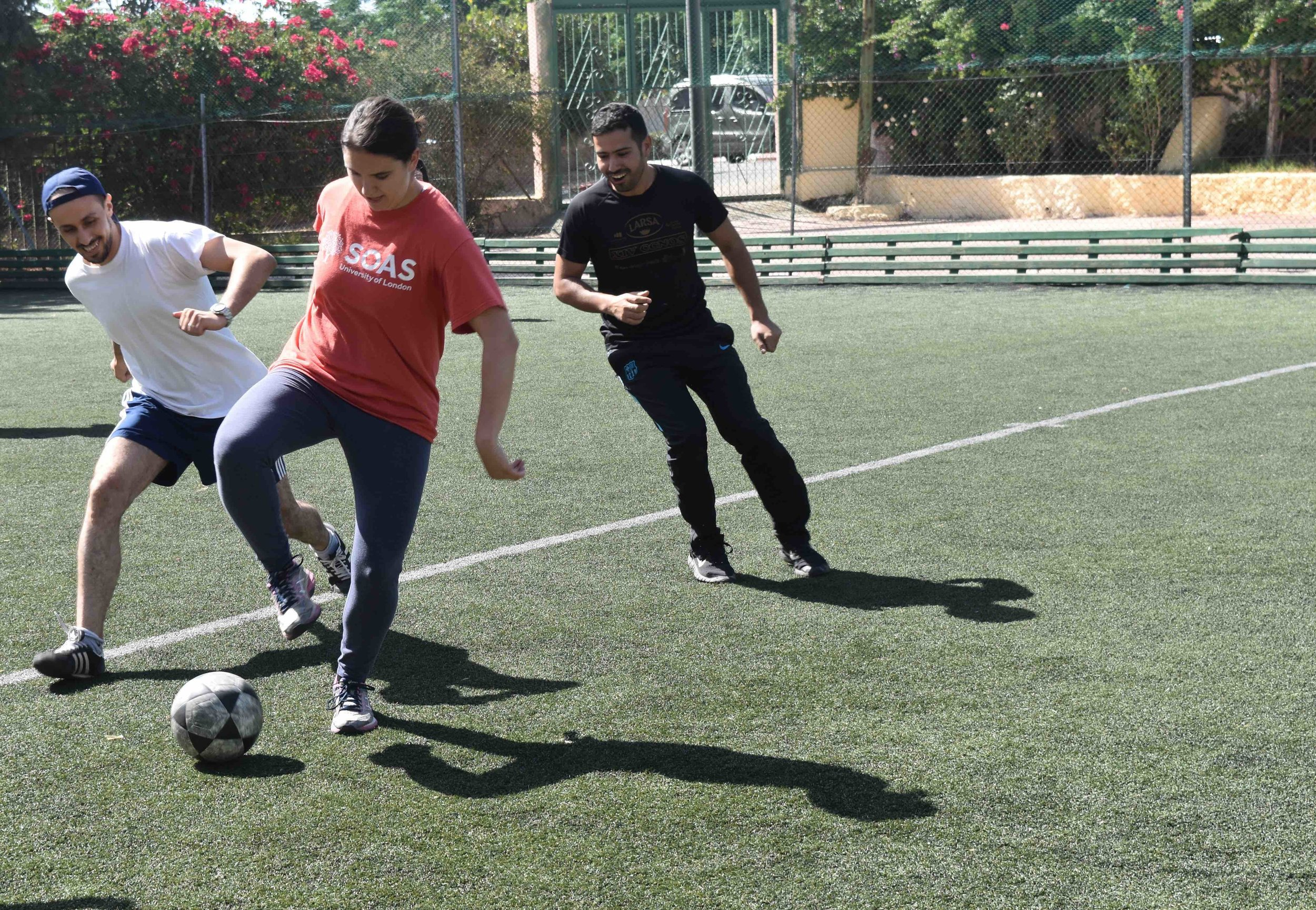 A student blocks the ball from Professors Said and Amrani.