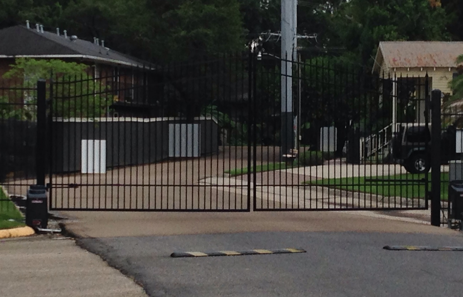 Gated road access as Tiger Manor Apartments
