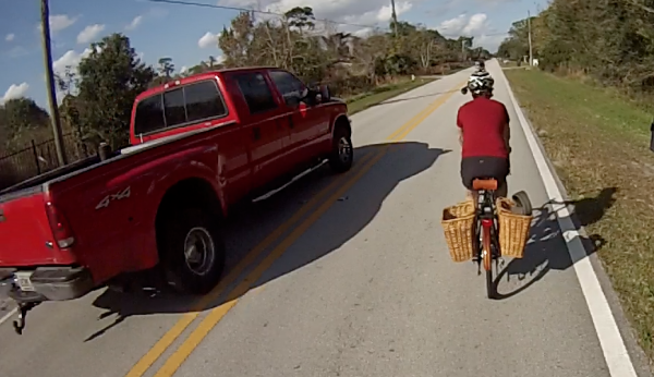 Driver obeying Louisiana law giving riders at least 3' of space.