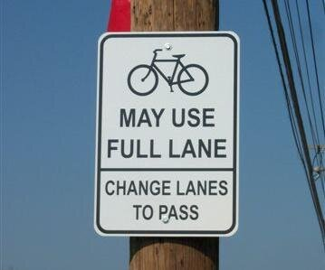 """""""share the road"""" is ambiguous and confusing."""