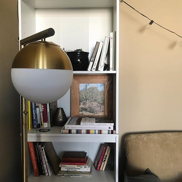 Until it can be properly hung, this painting is in good company (namely the coffee table book of Georgia O'Keeffe's desert homes).