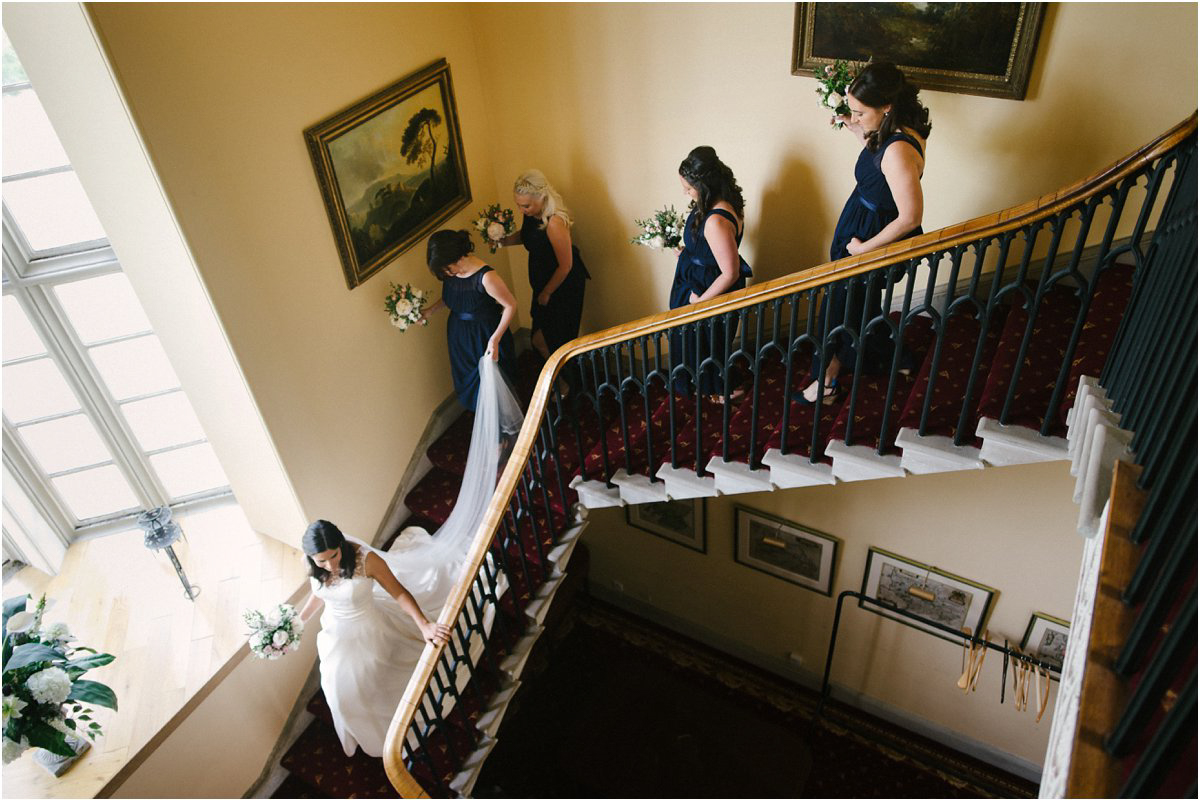 Bride going down the Blairquhan castle staircase by Cro & Kow