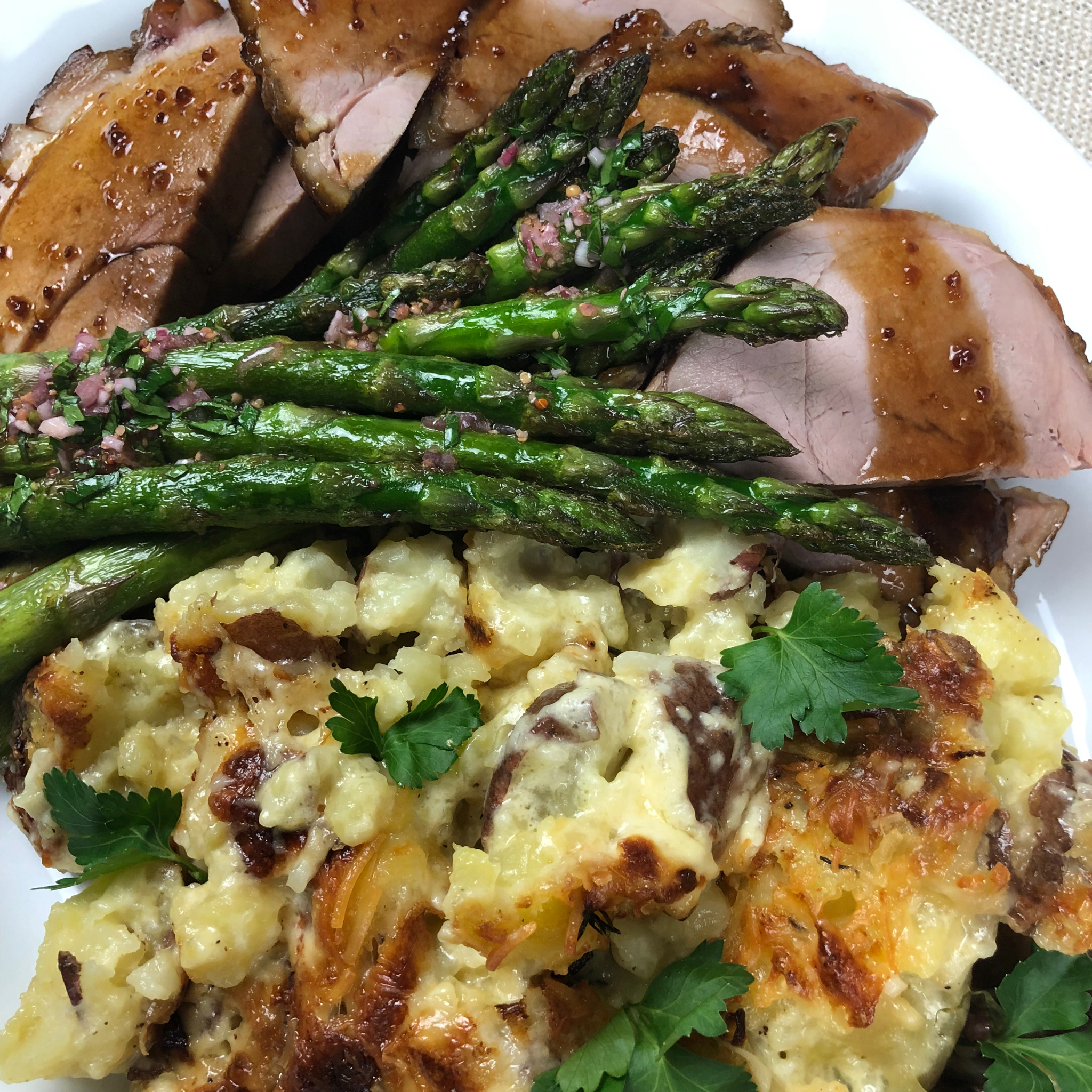 Smashed Potatoes au Gratin, here served with asparagus and Broad Arrow Farm  Smoked Ham.