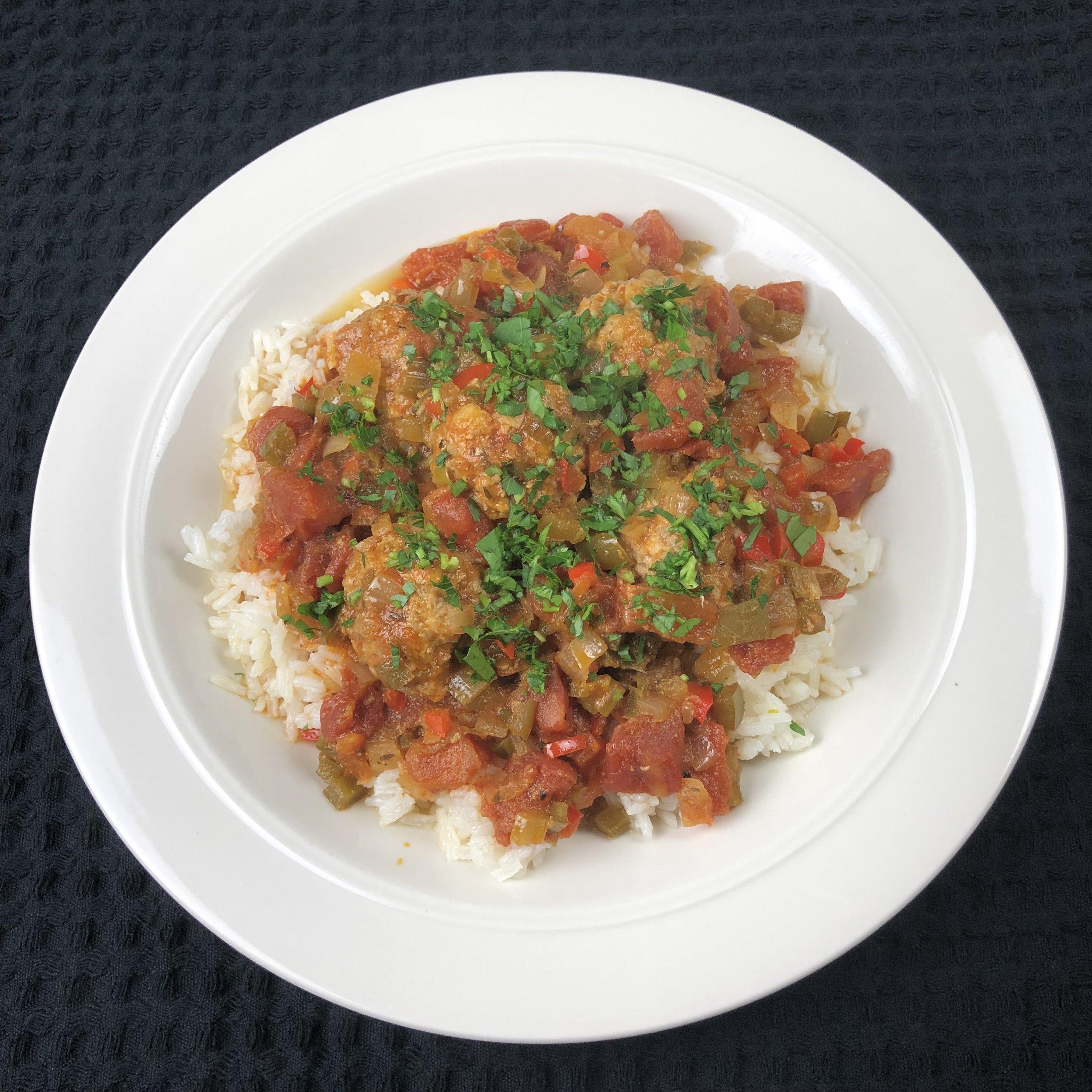 Cajun pork meatballs served over rice with sauce piquant.  Laissez les bon temps rouler !