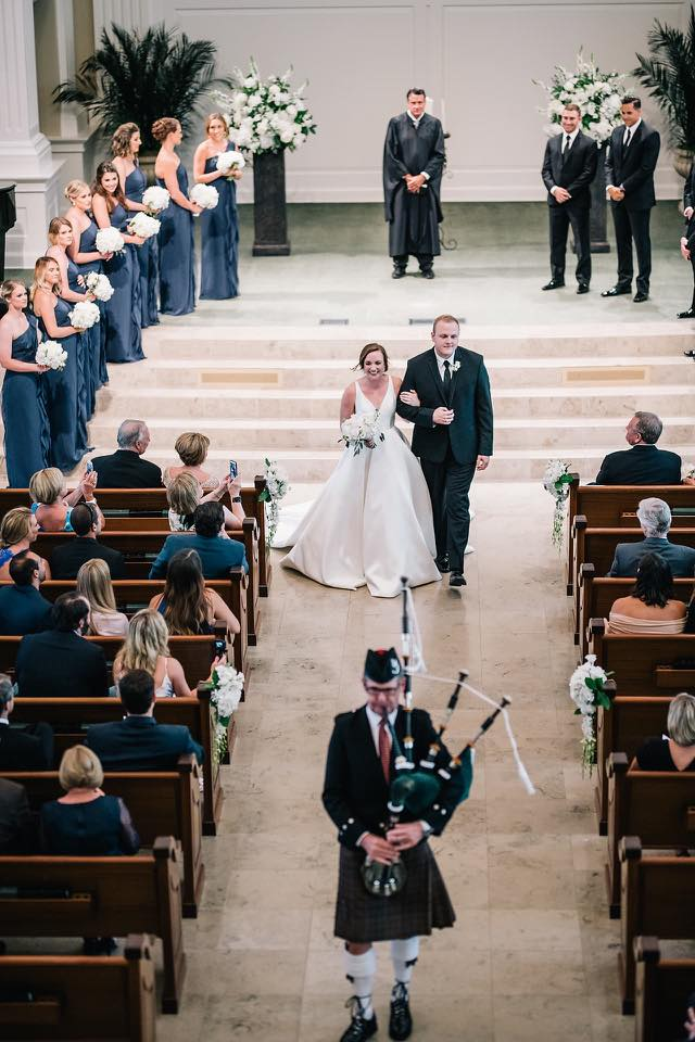 married down the aisle with bagpiper.jpg