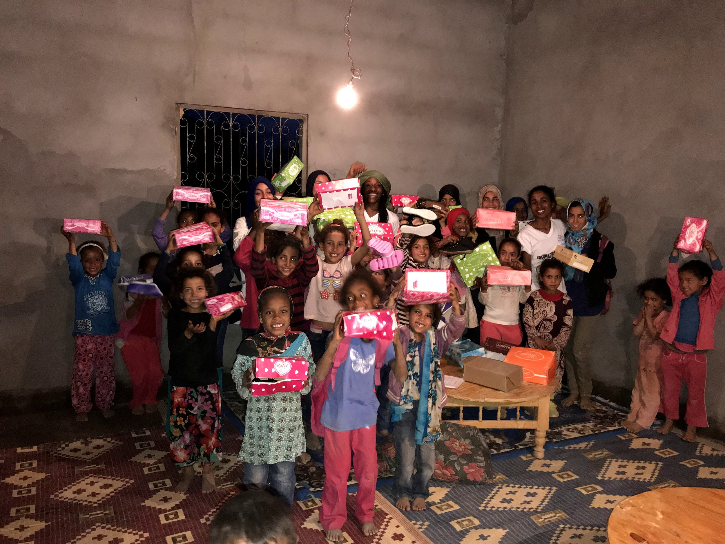Happy Feet! - Kids in rural parts of Morocco walk miles to school. We donated 80 pairs of new shoes!