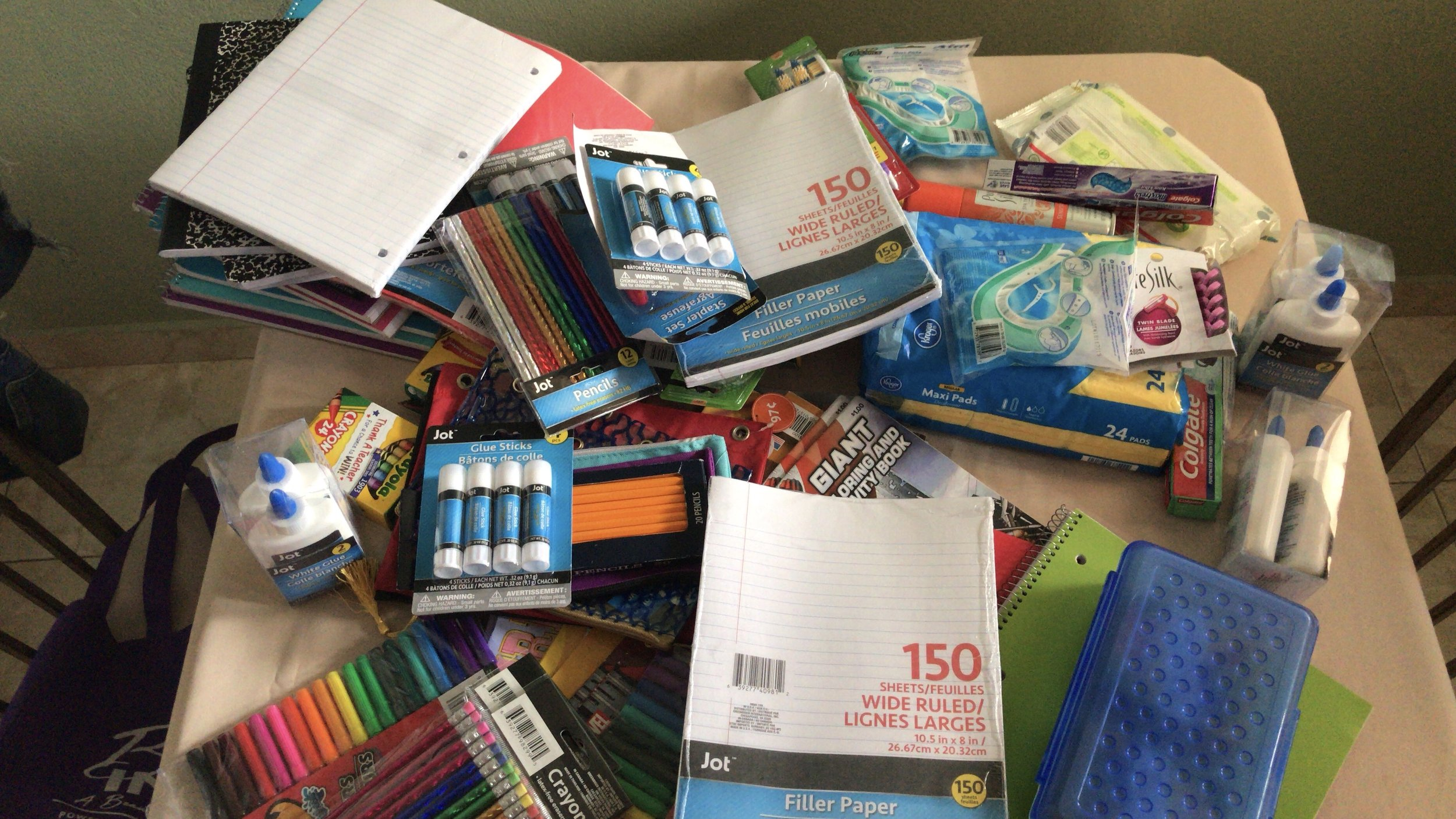 School Supplies - Destination Impact has donated notebooks, paper, folders, crayons, pencils, pens, books, coloring books, markers to children in need.