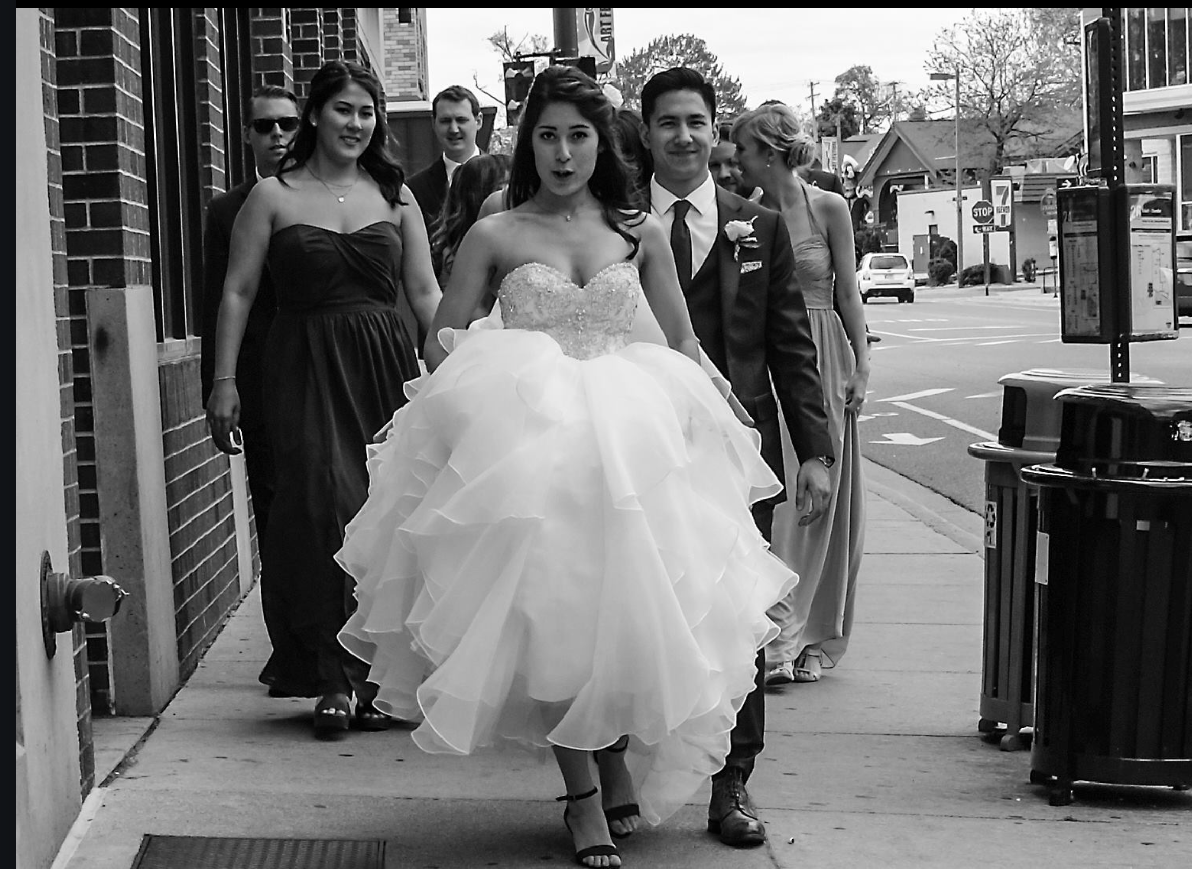 A confident bride strutting down the street.