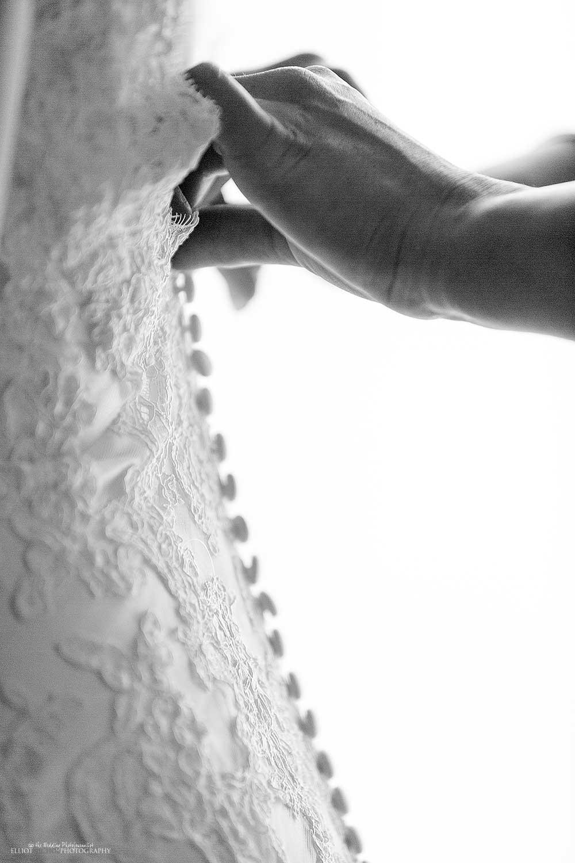 wedding-dress-detail-hands-buttons-photography