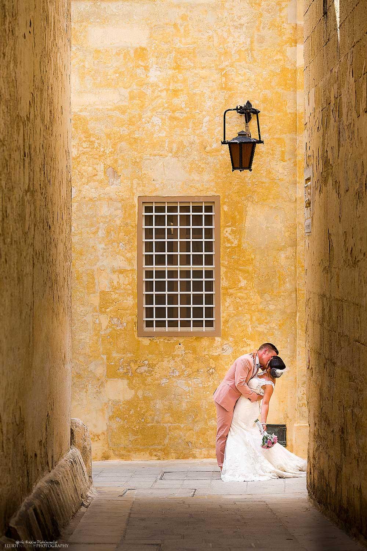 mdina-kissing-bride-groom-malta-destination-photography