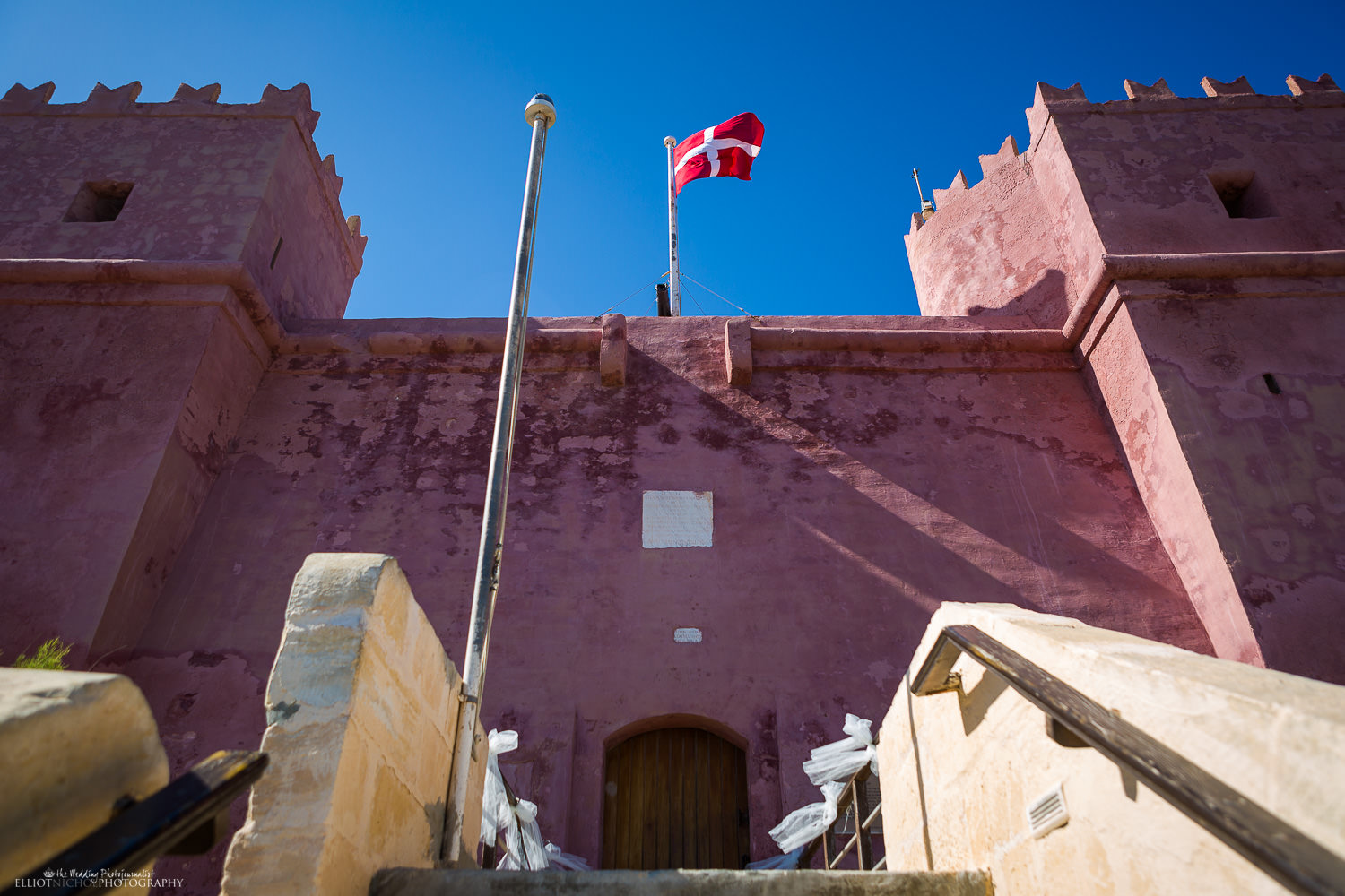 red tower entrance with flag mellieha malta