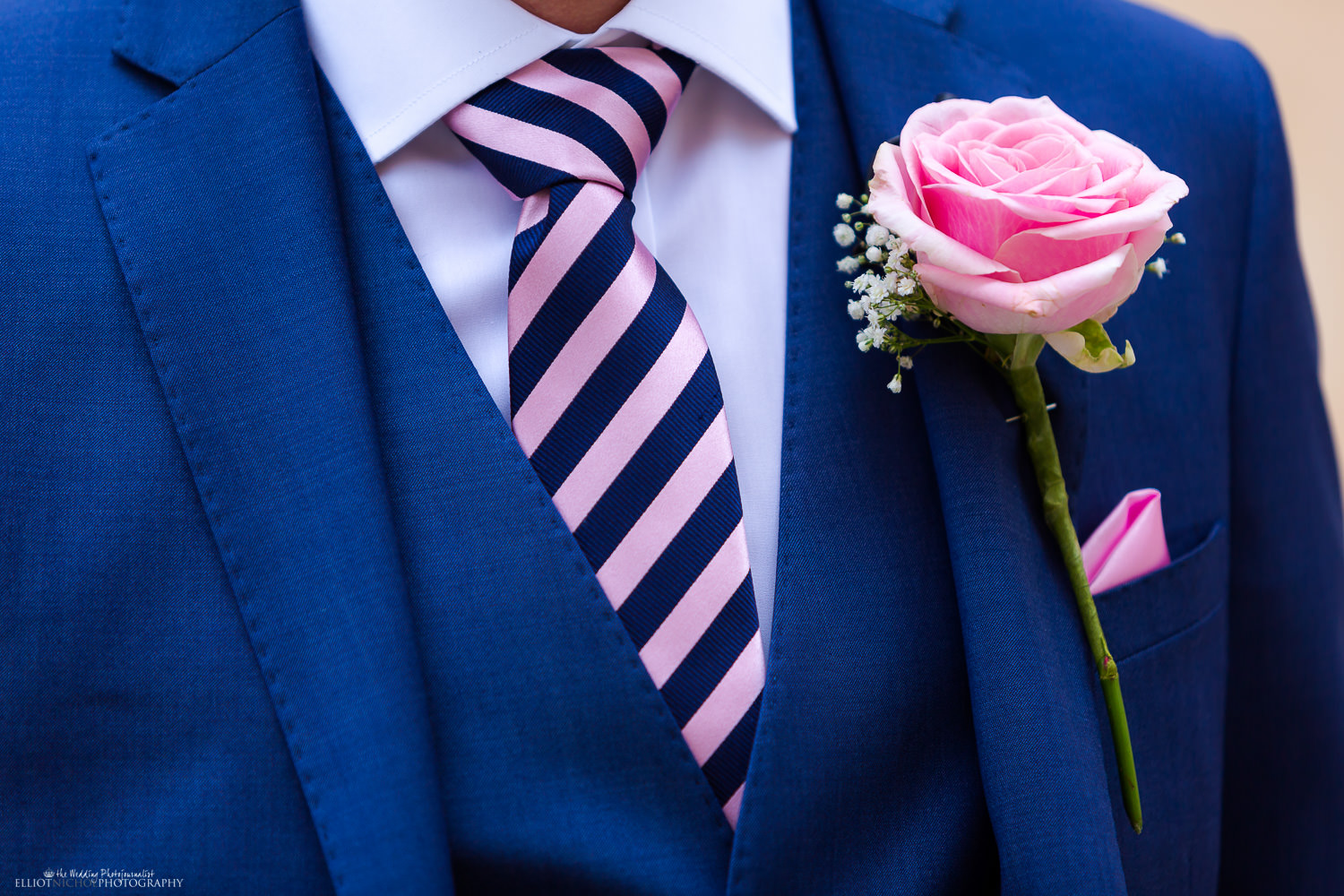 Groom in his wedding suit - blue and pink