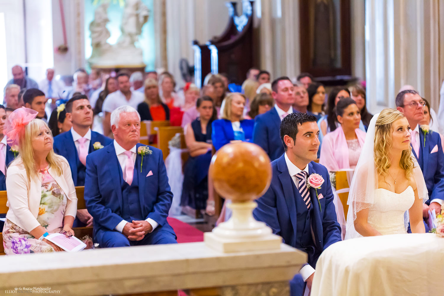 Bride and groom sit next during the wedding Ceremony