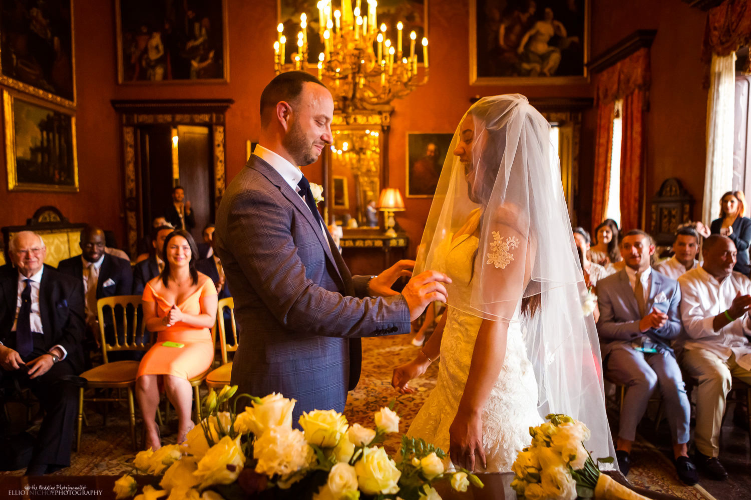 Groom lifts his brides veil to kiss his wife at the Palazzo Parisio, Malta.