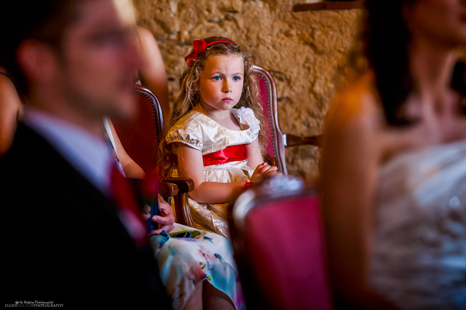 Child wedding guest watching the wedding ceremony in Sicily.