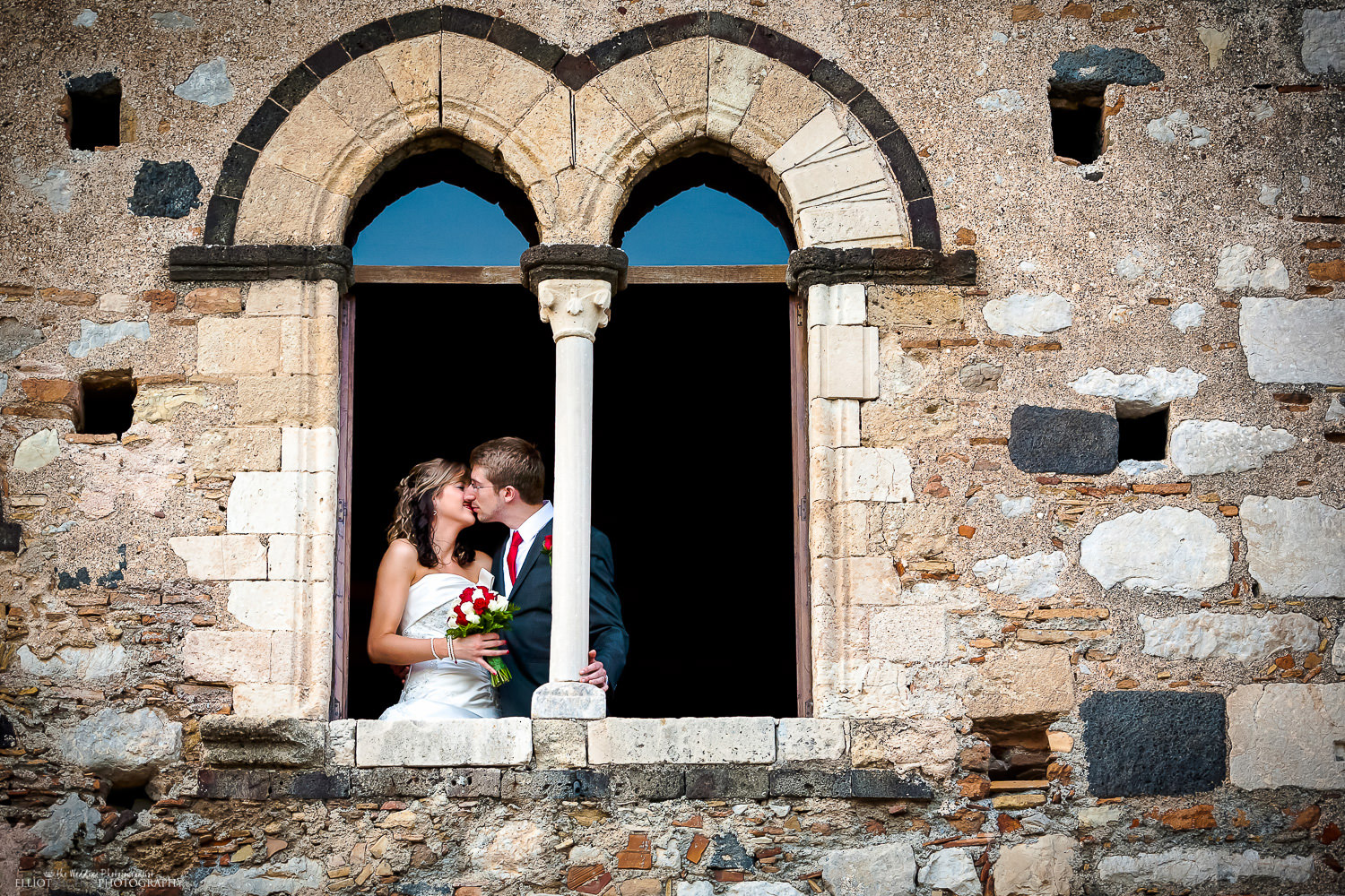 Bride and Groom kiss after wedding at Palace of the Dukes of Santo Stefano in Taormina.