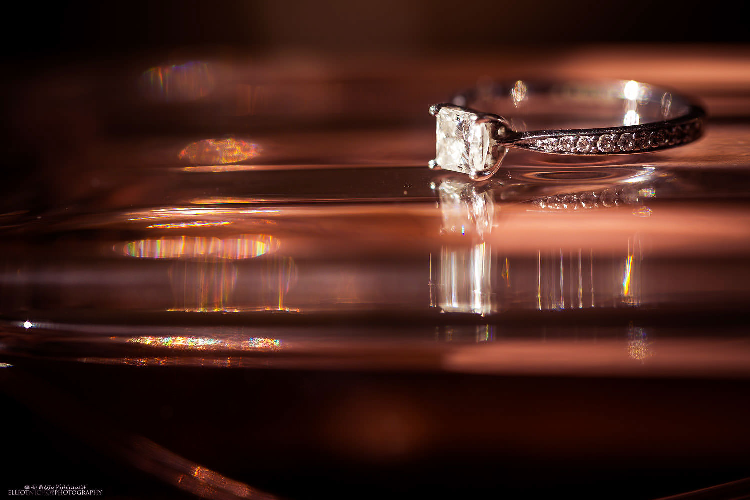 Engagement ring placed on Brides perfume bottle.